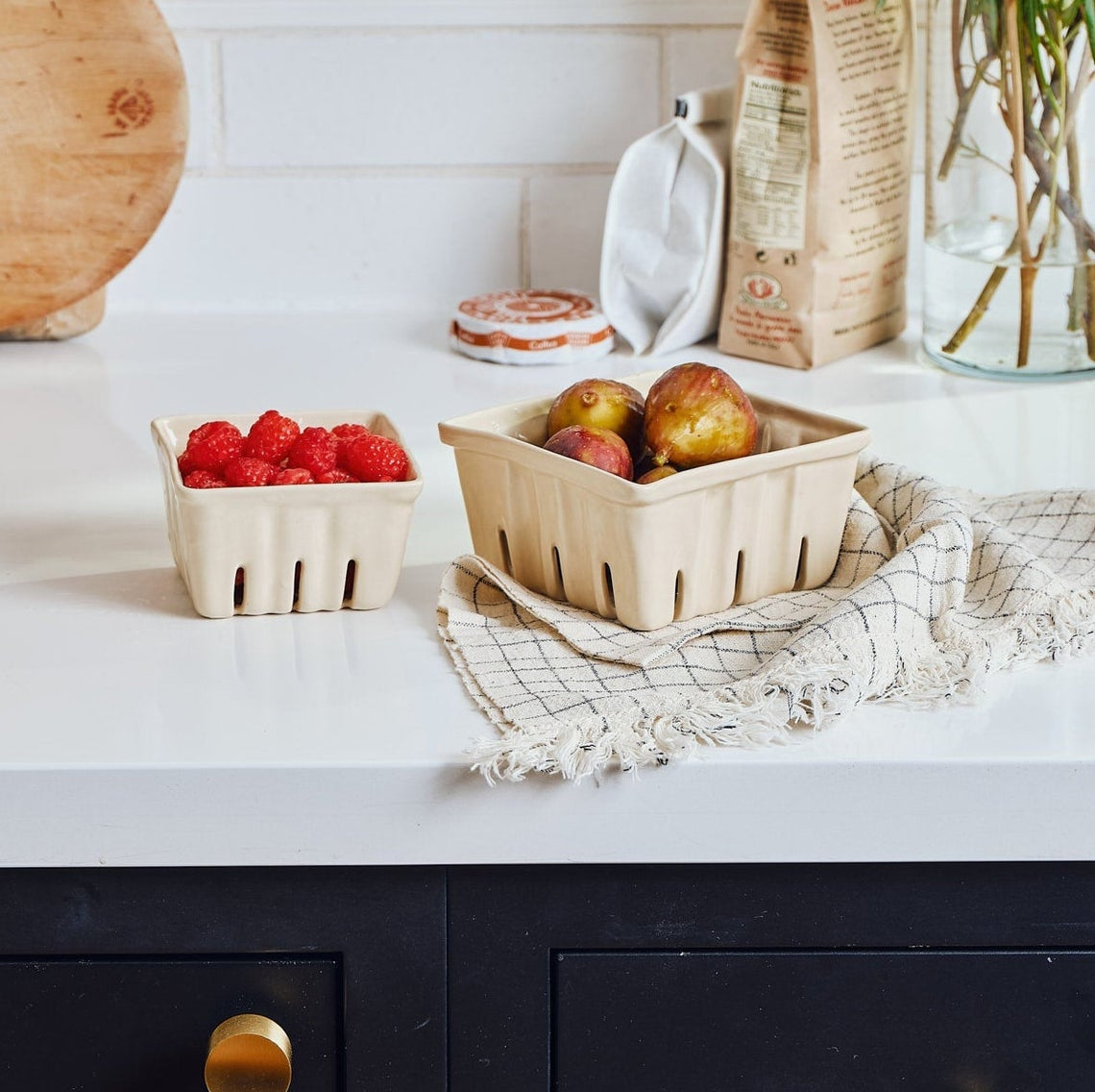 ceramic berry baskets on counter