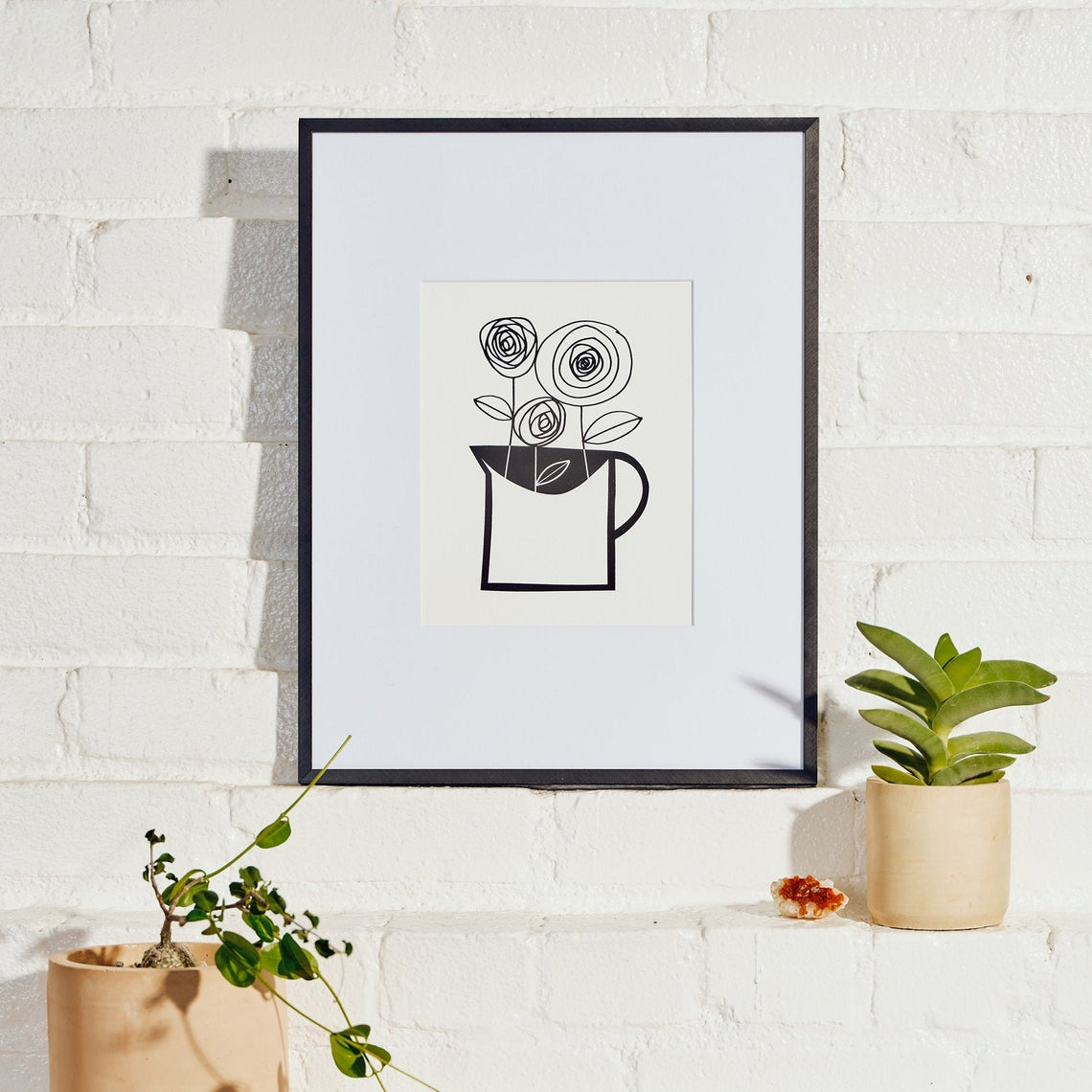 Black and White print of flowers in vase