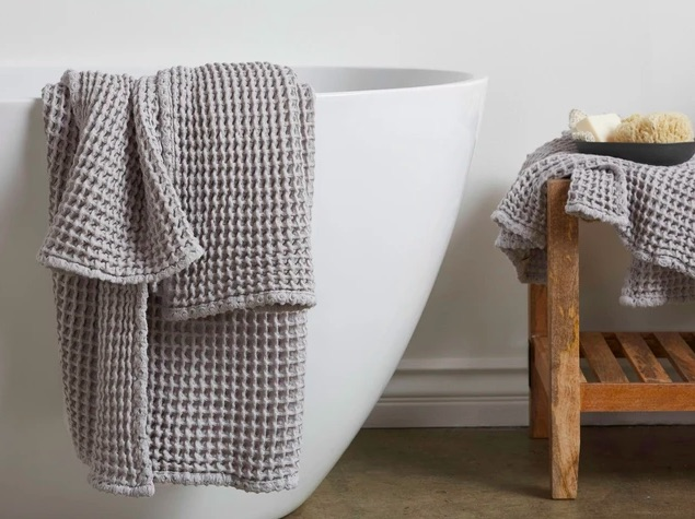Parachute waffle weave towel in light gray on tub
