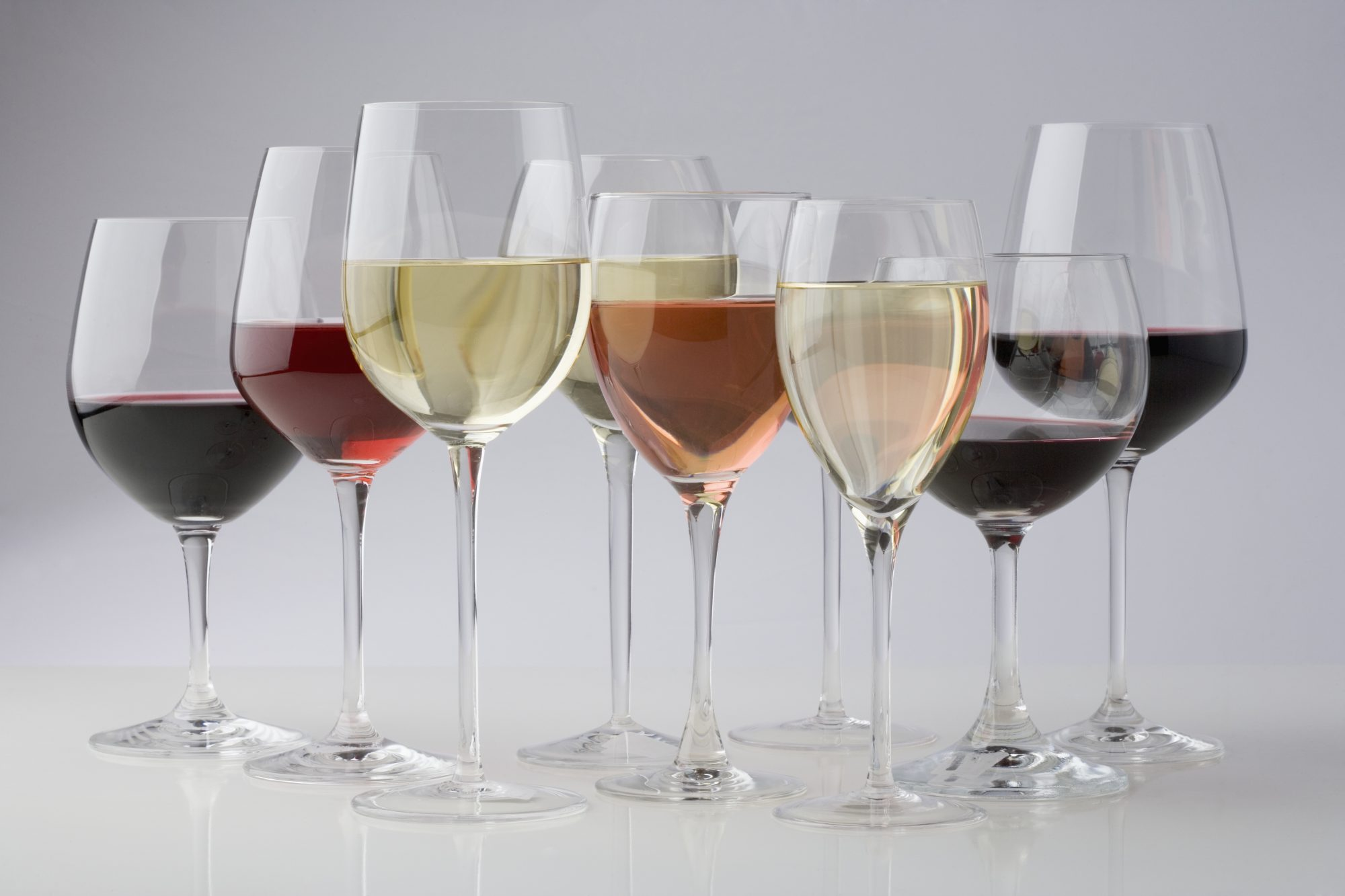 different types of wine glasses paired with wine