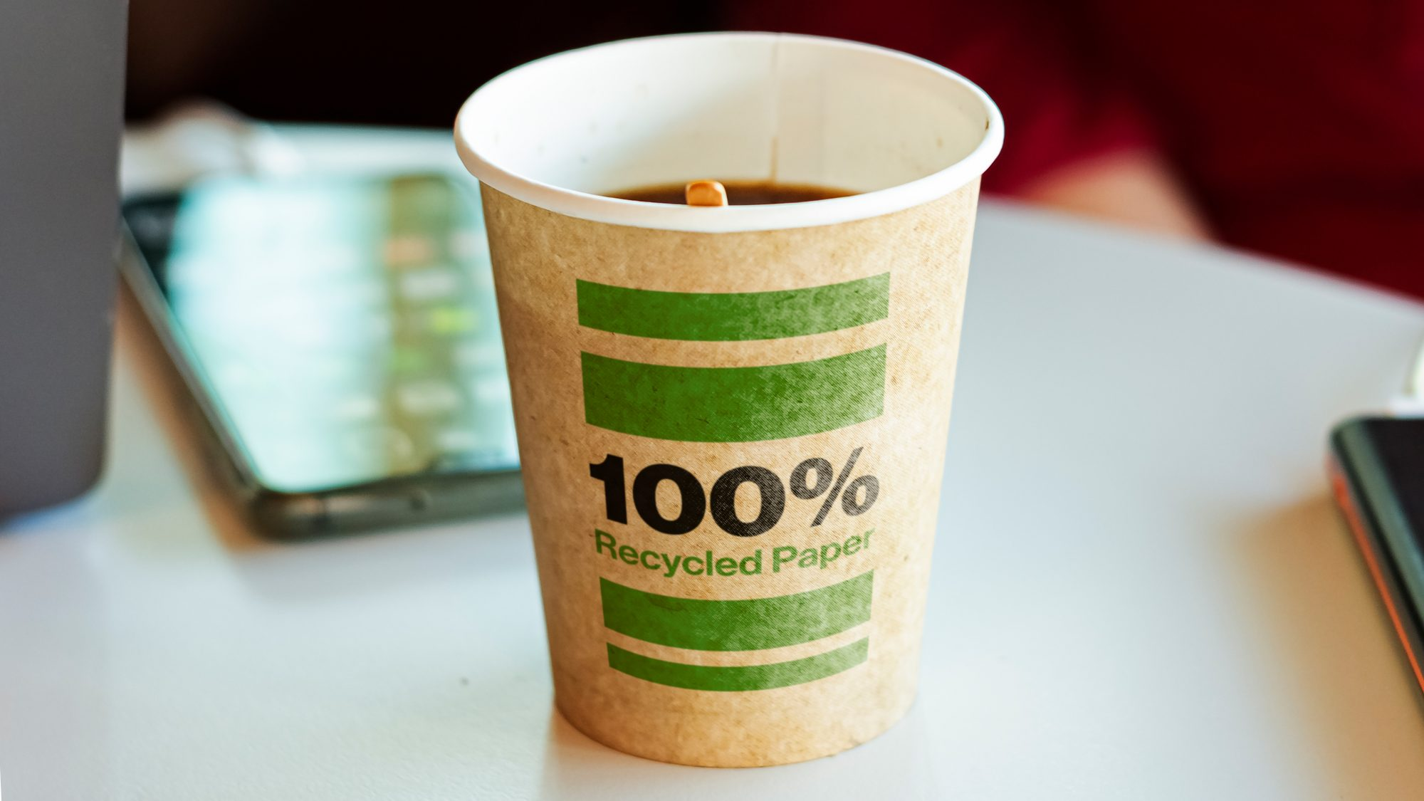a recycled paper container containing hot coffee for a break. Environmental protection and ecological issues