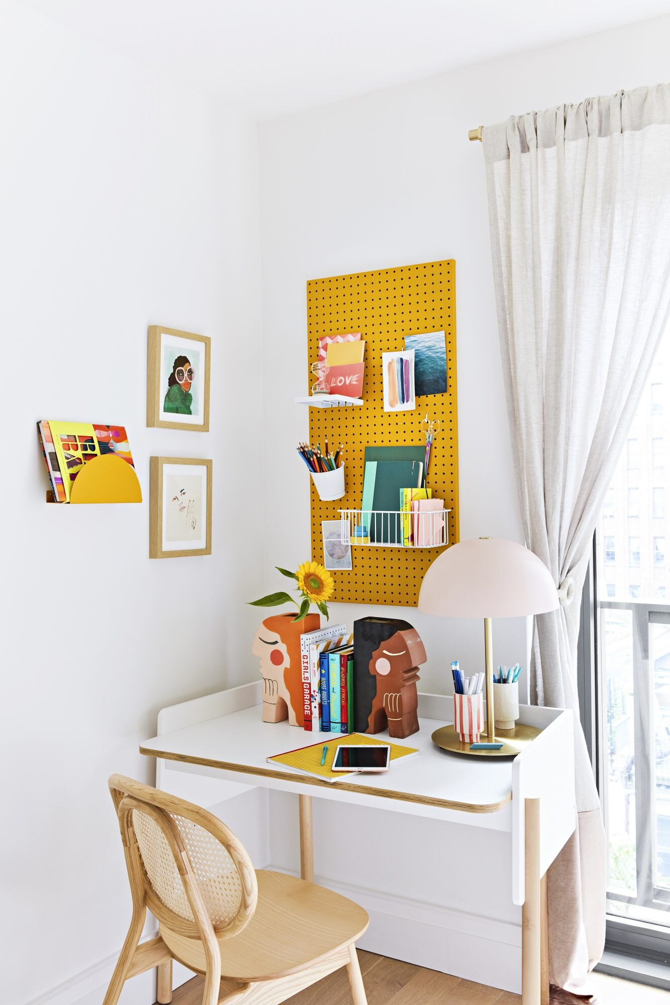 Tween bedroom with pegboard organizer at desk