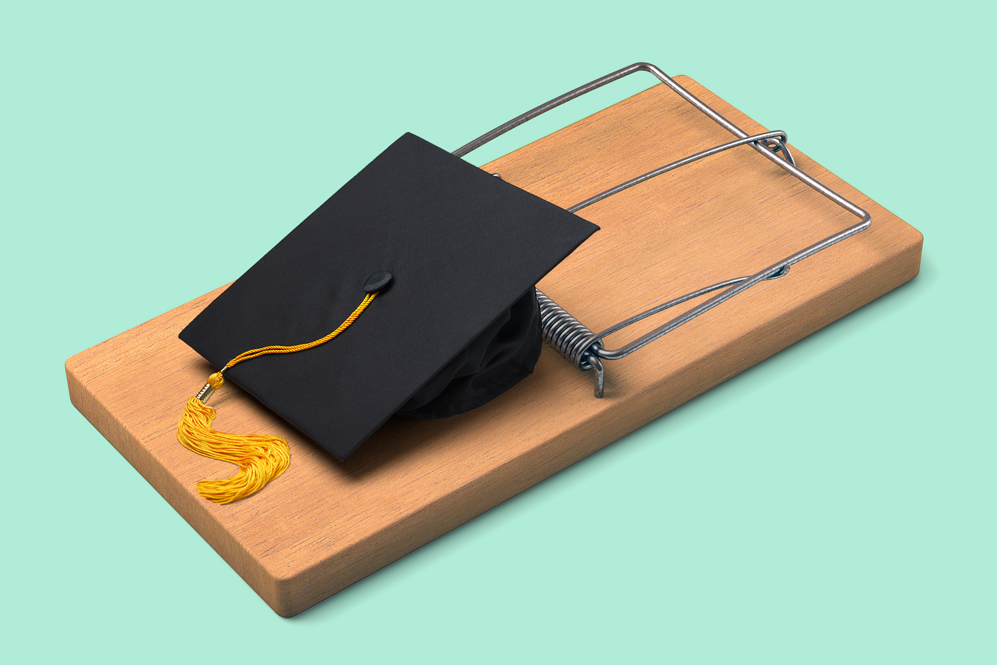 Student loans - graduation cap in mousetrap