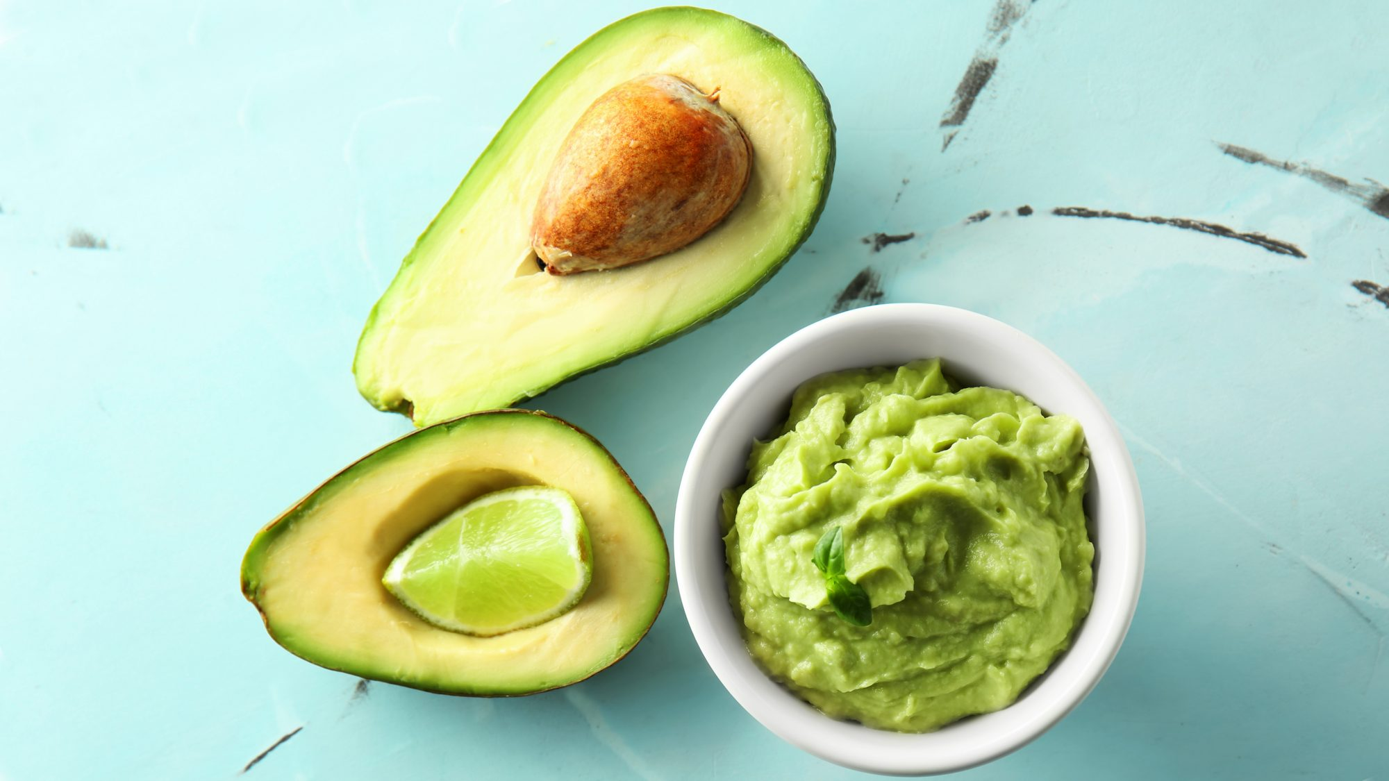 avocado-mistakes: sliced avocado and guacamole