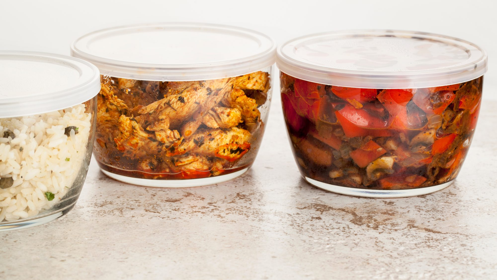 how-to-reheat-leftovers: leftovers in glass storage containers