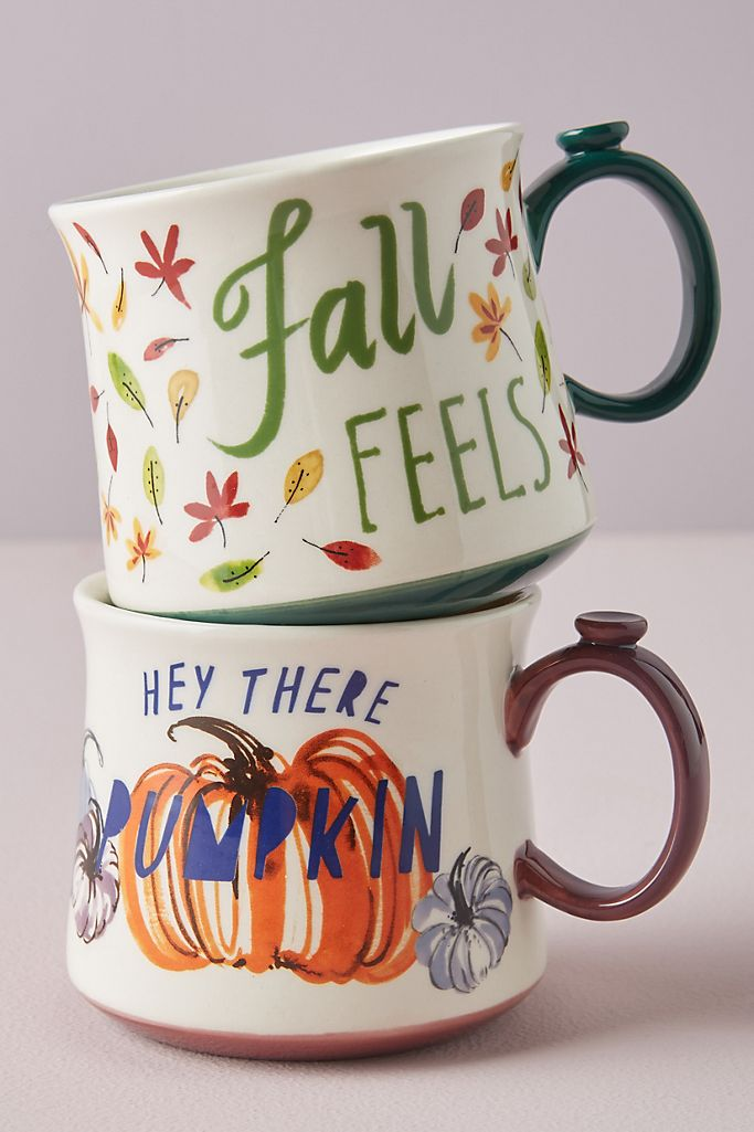 "mugs with ""Fall Feels"" and pumpkins"