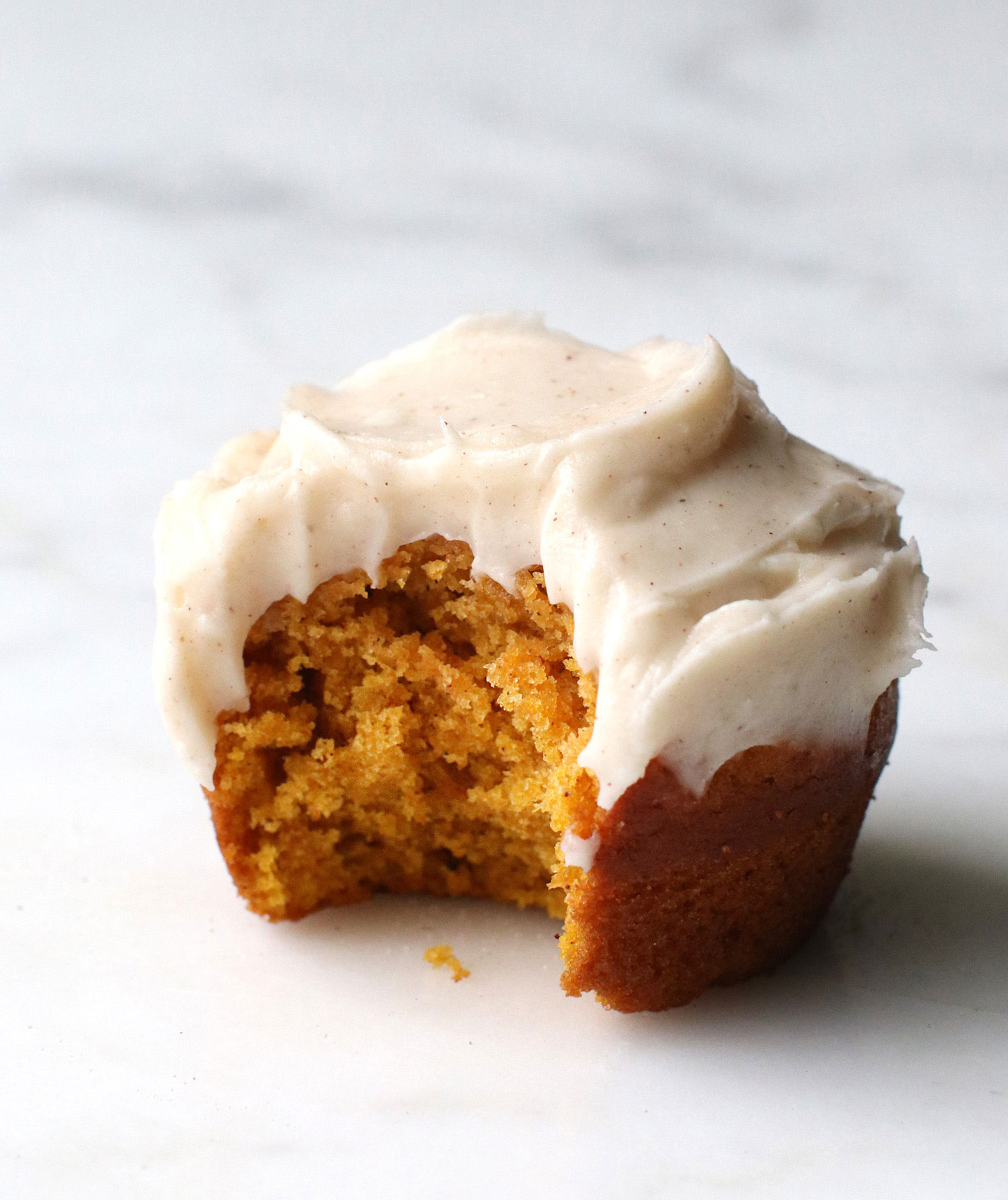 Halloween food ideas, easy Halloween party food - Pumpkin Muffins With Cinnamon Cream Cheese Frosting