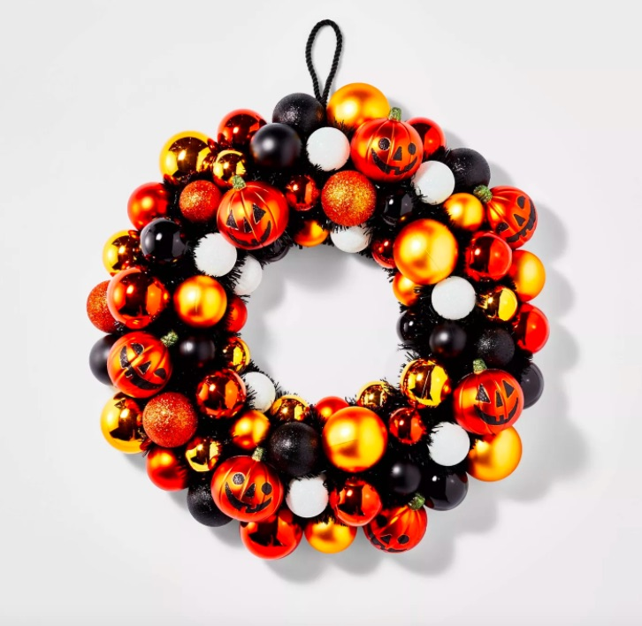 Halloween themed ornament wreath in orange and black