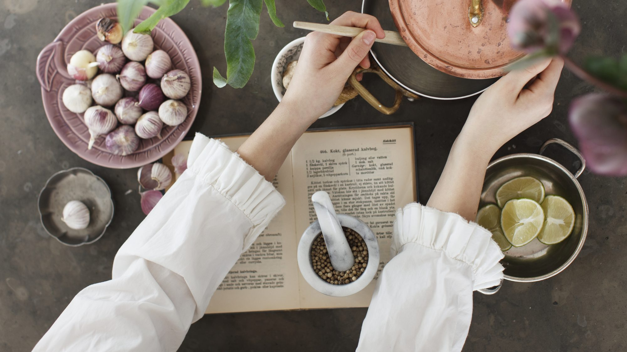 How to organize recipes, woman cooking from recipe