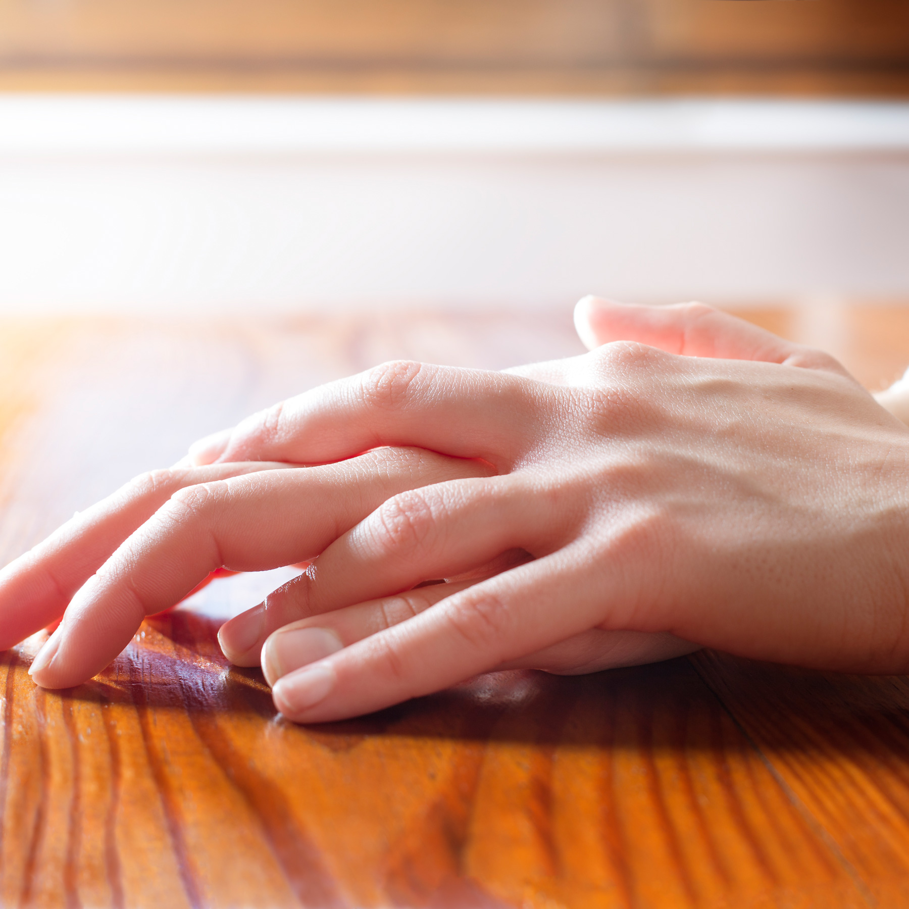 How to break bad habits (fidgeting): Woman folding her hands on the table, close up shot