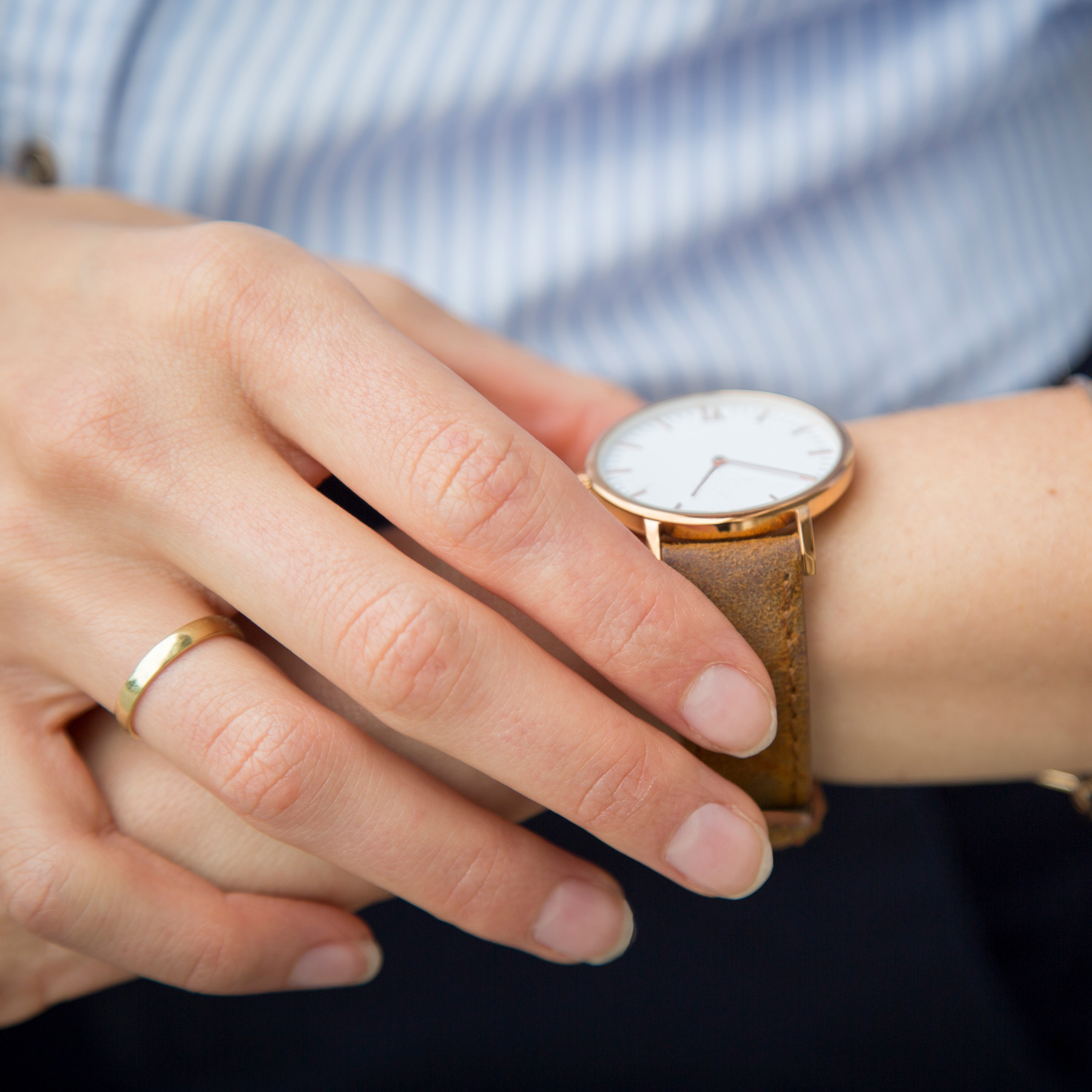 How to break bad habits (always running late), woman checking her watch close up shot