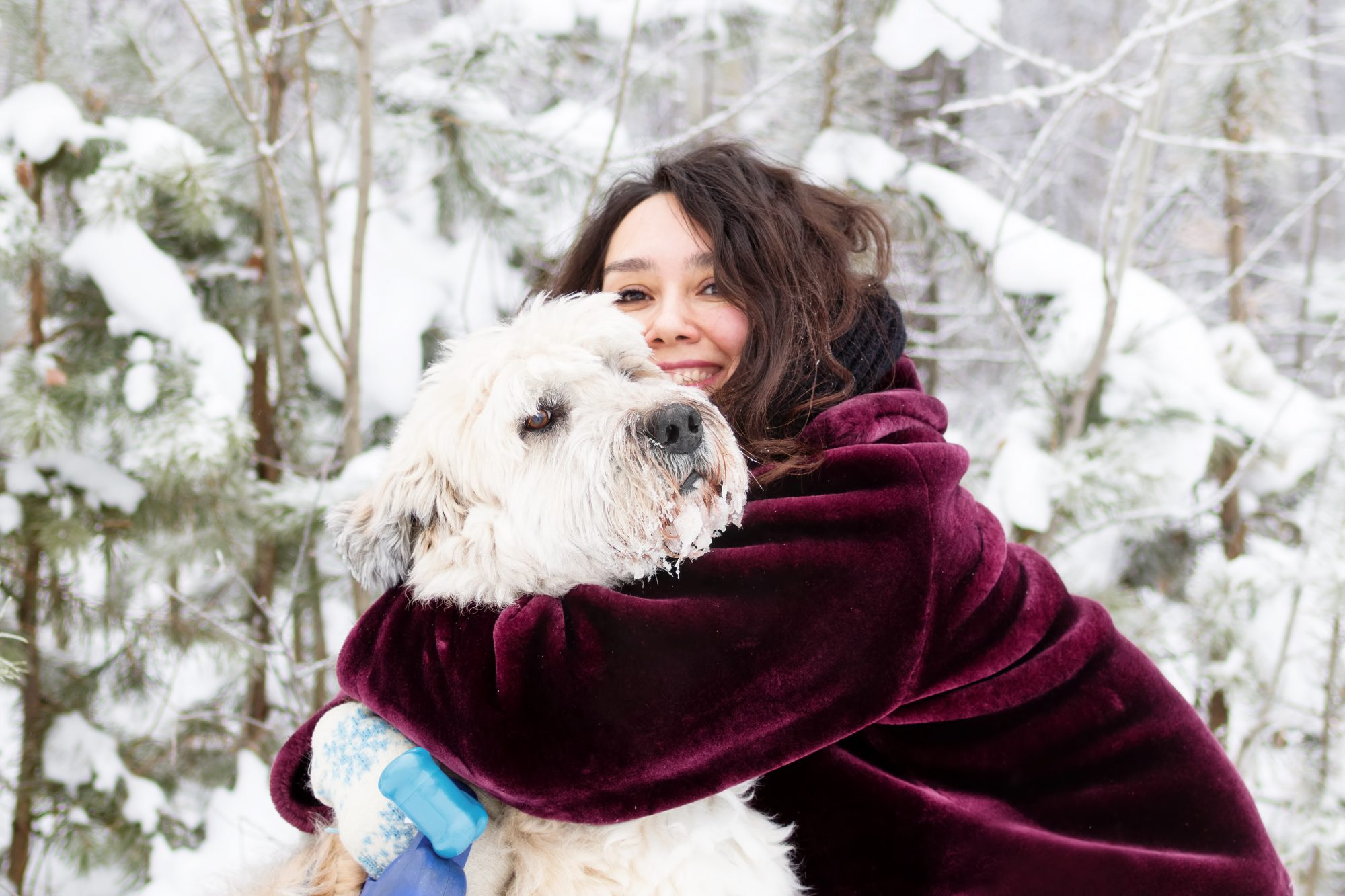 How to feel happier this fall and winter - woman with dog