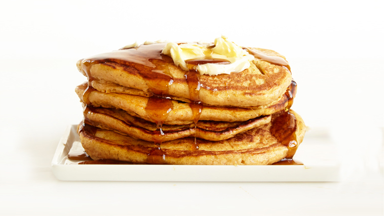 Pumpkin Pancakes Drizzled With Warm Spiced Maple Syrup Are the Best Fall Breakfast