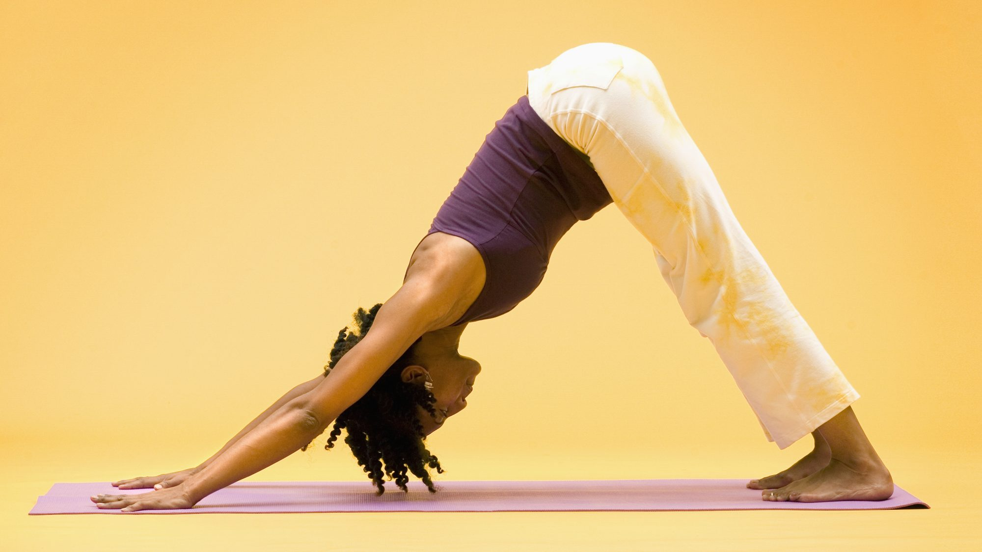 full-body-yoga-moves-for-energy: woman in downward dog yoga