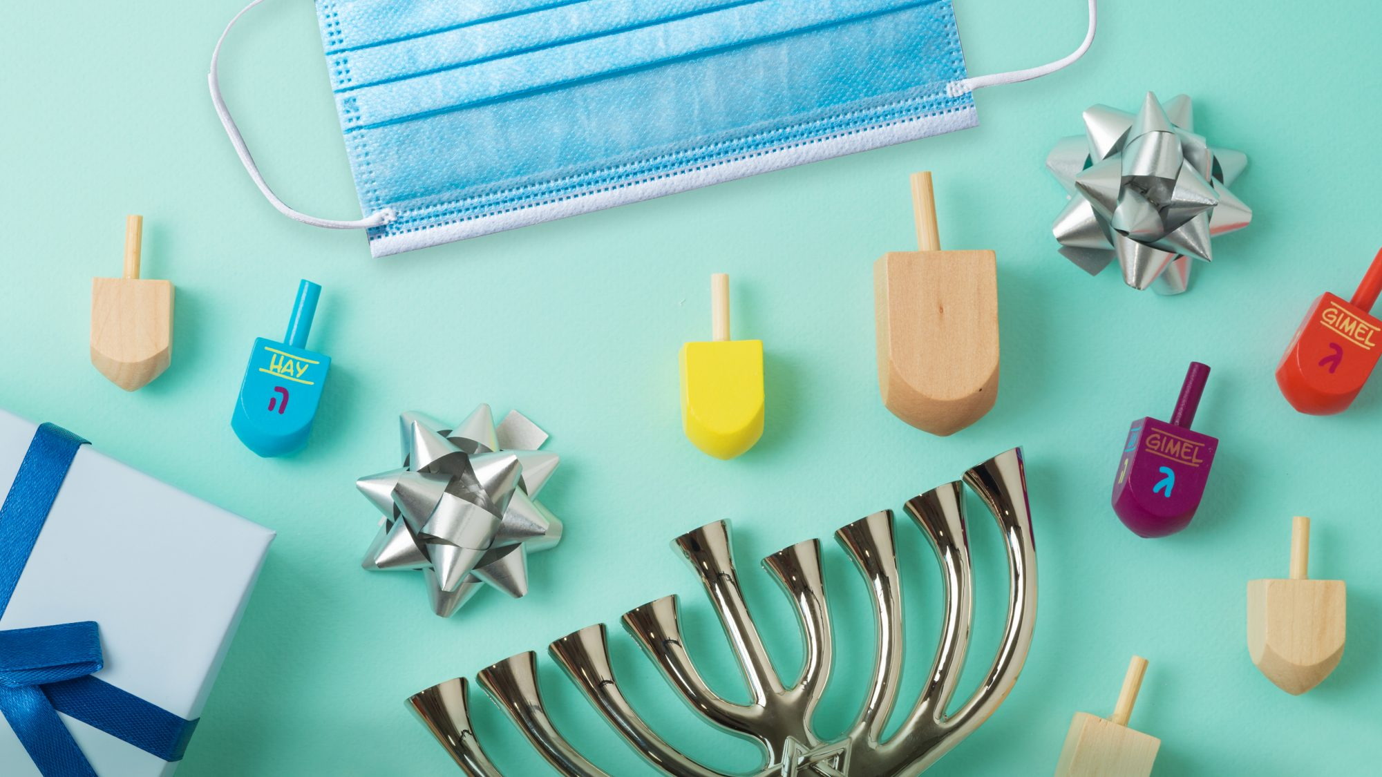 How to celebrate Hanukkah safely during coronavirus - menorah and hanukkah items with mask
