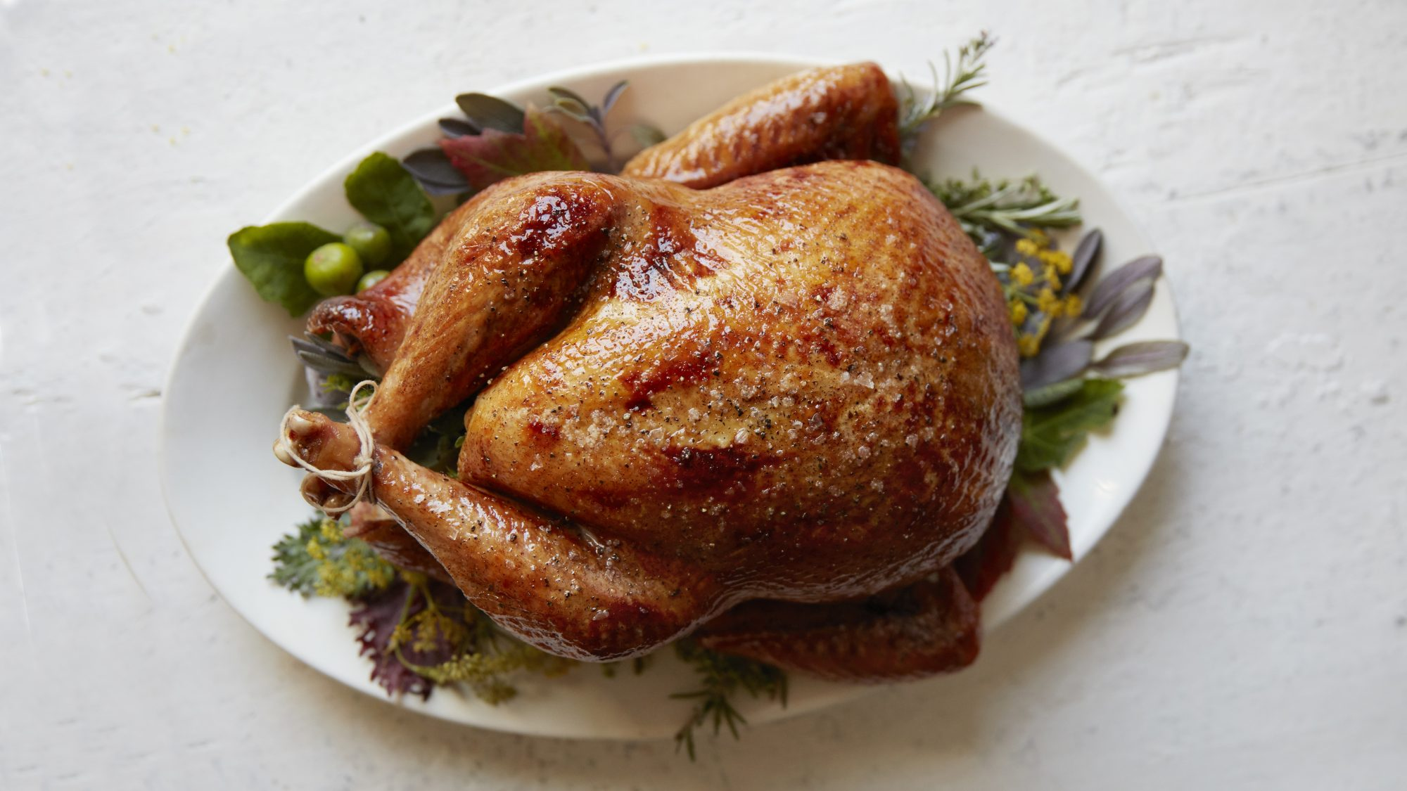 how-to-buy-turkey-guide: cooked turkey on a platter
