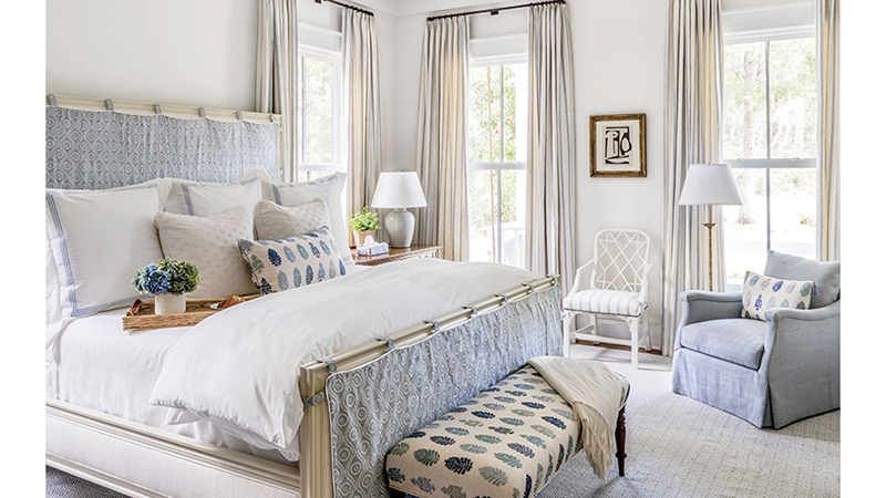 farmhouse bedroom with drapes and large windows
