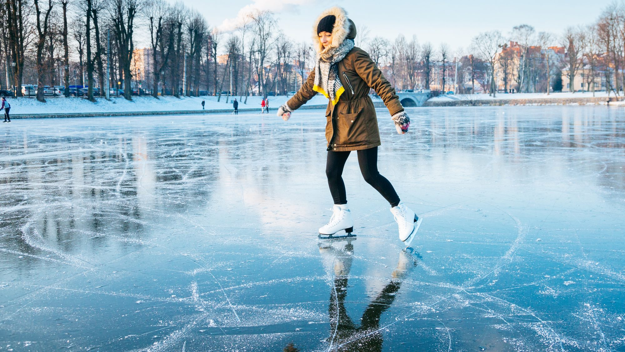 Fun Things to Do in December 2020: Woman ice skating outside