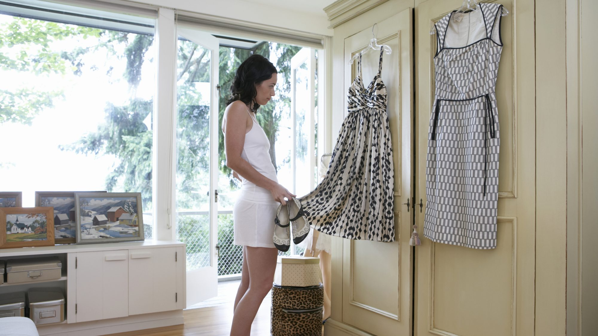 Things to get rid of fall 2020, woman decluttering closet