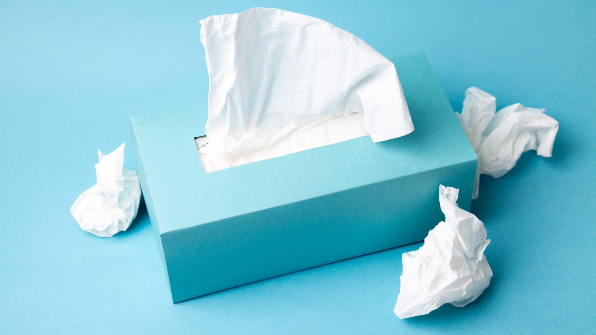 How to Stay Ahead of Cold and Flu Season 2020: blue tissue box on a blue background