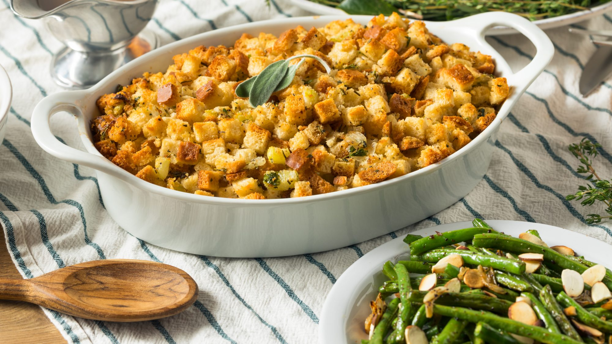 how-to-reheat-stuffing: reheated stuffing in a serving dish for Thanksgiving