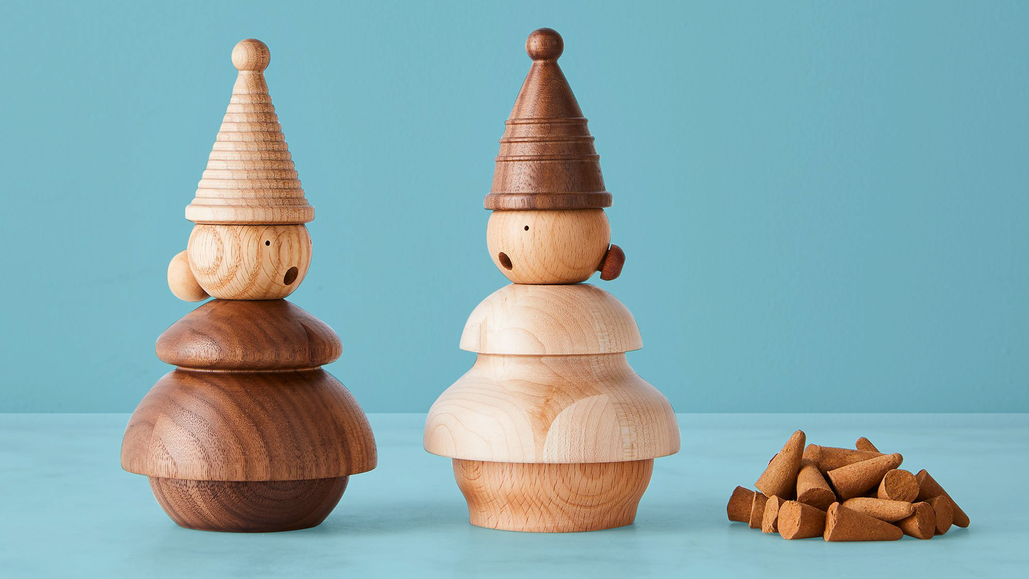 best housewarming gifts, ideas - incense gnomes on blue background