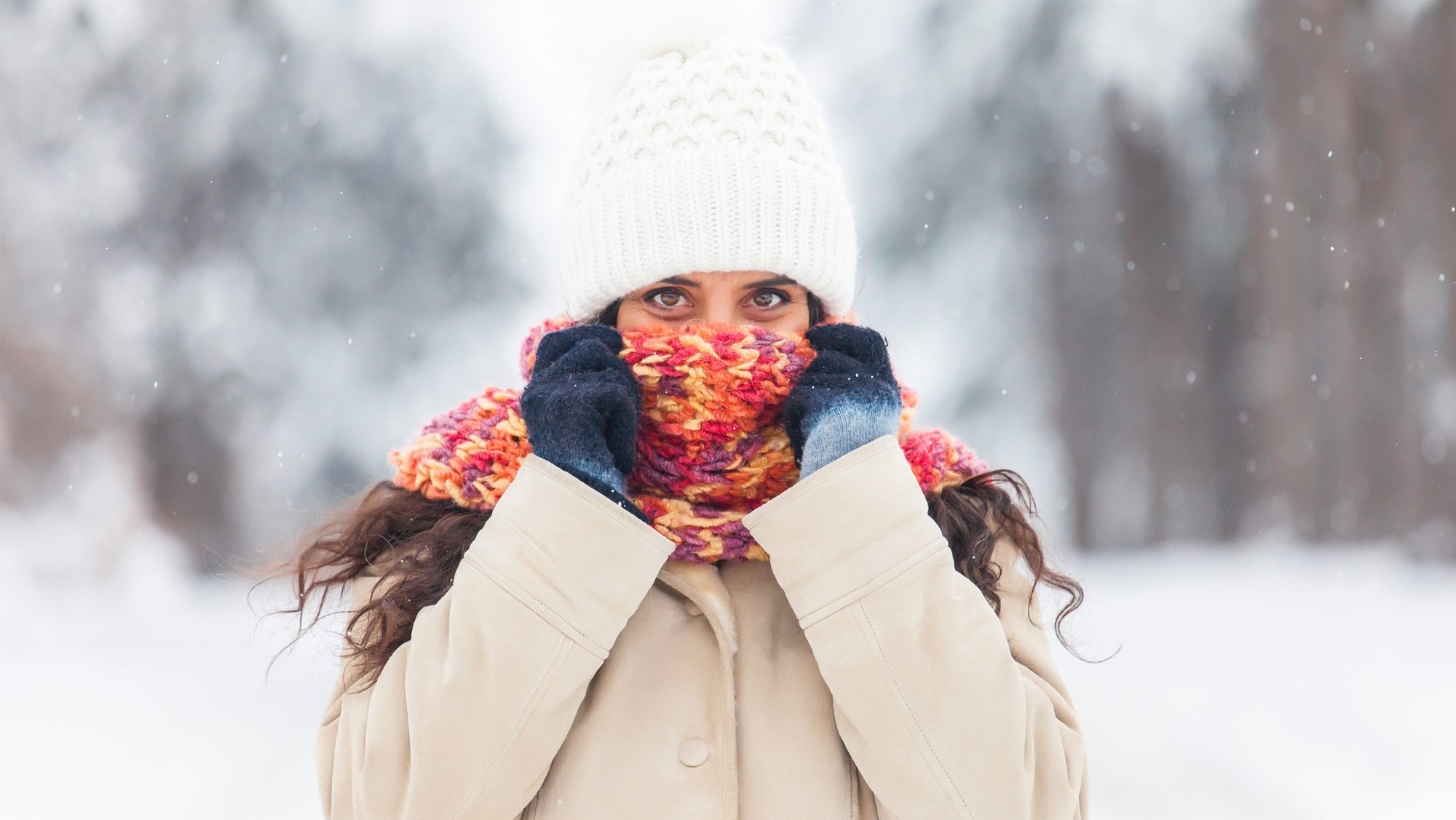 dry-skin-remedies: woman covering face with hat and scarf