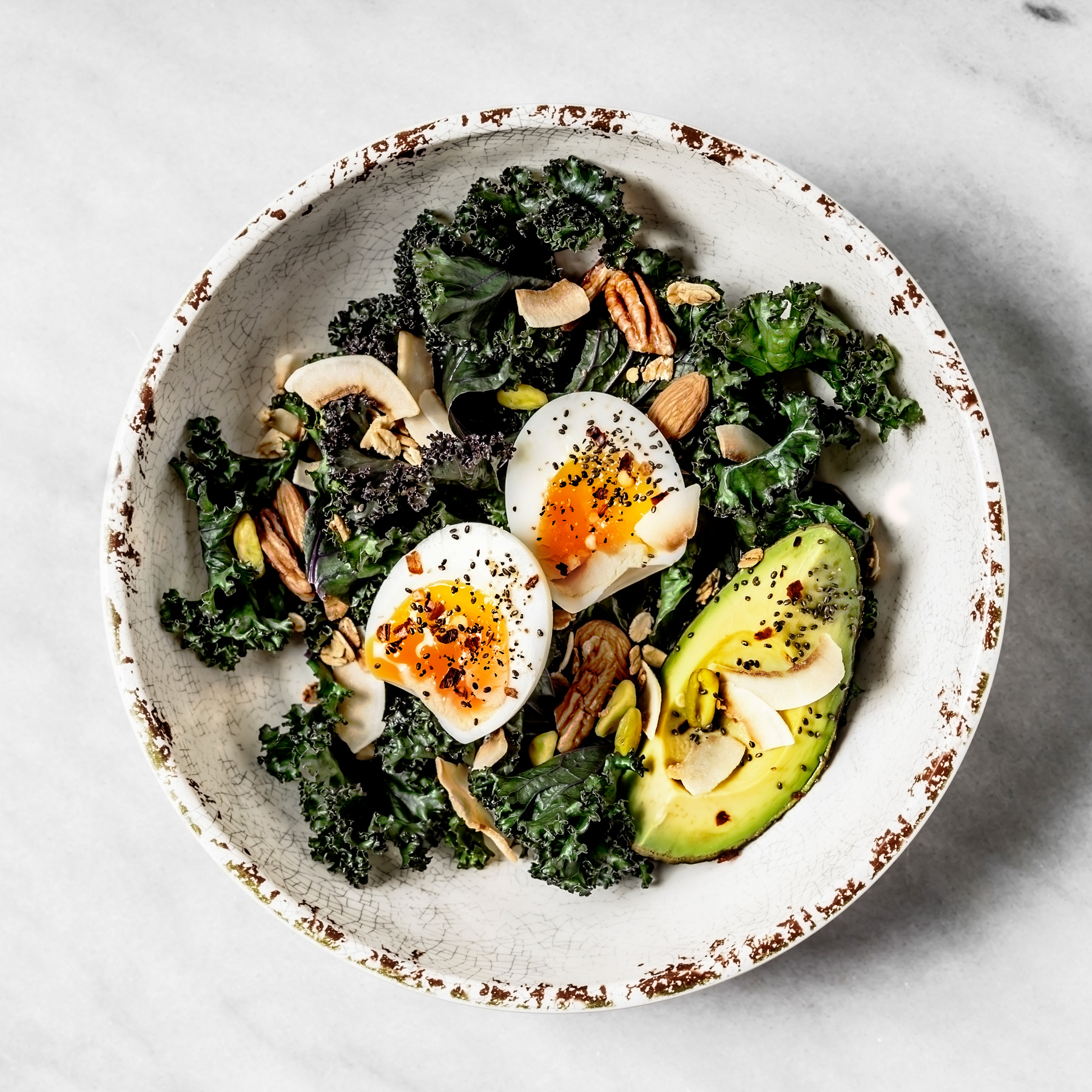 10 Ways to Make Your Home Greener: vegetarian salad dish with kale, avocado, and egg