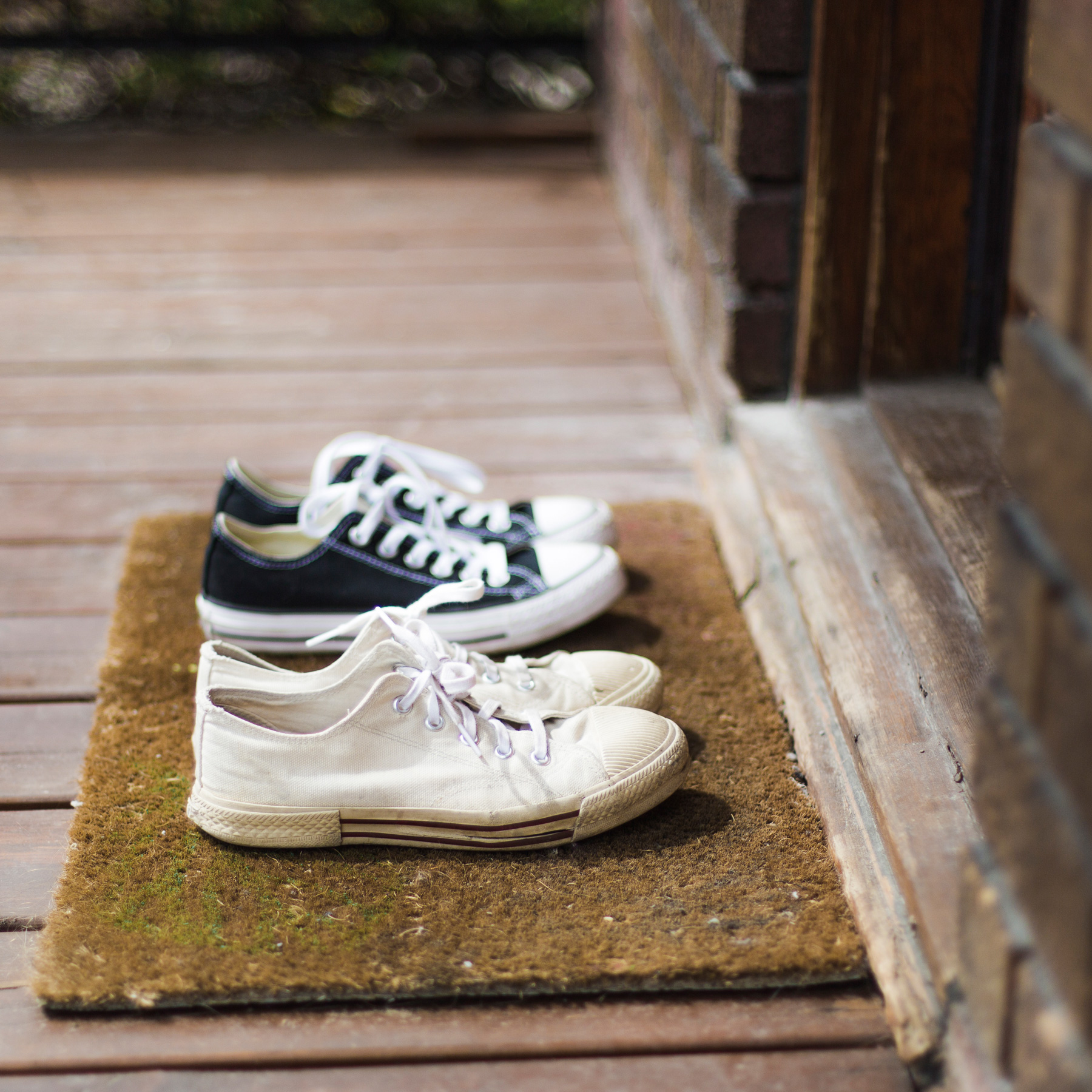 10 Ways to Make Your Home Greener: sneakers outside on the doormat