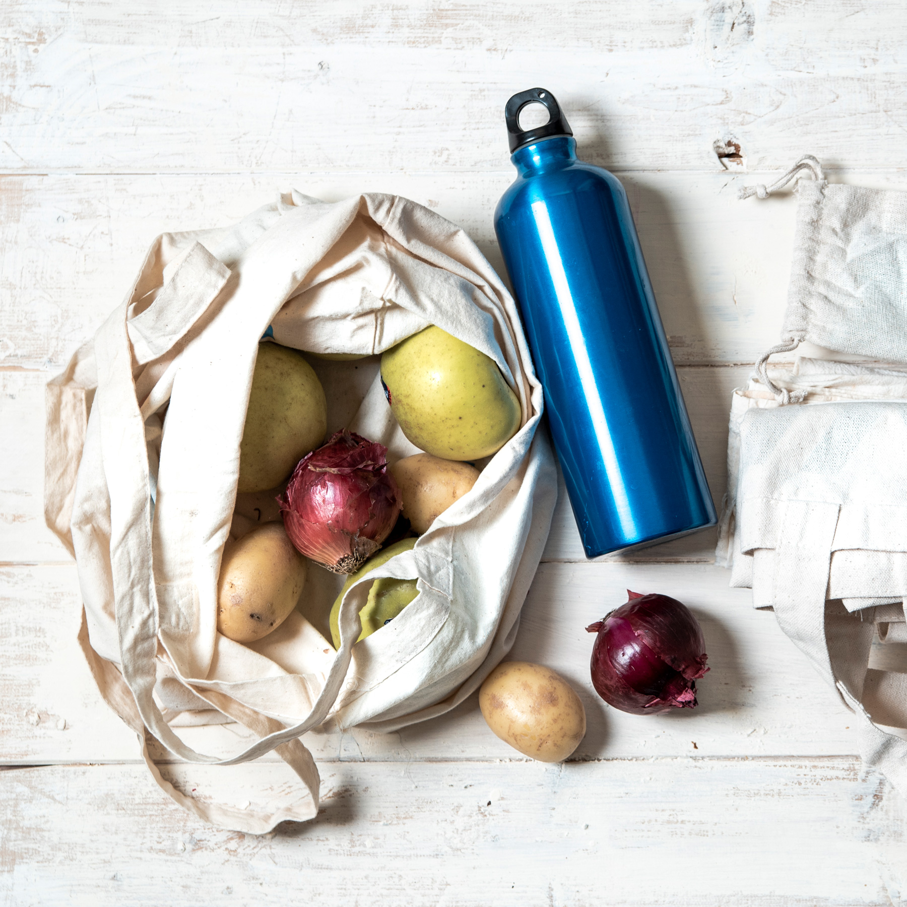 Painless Changes You Can Make for a Green Home: reusable grocery bag and water bottle