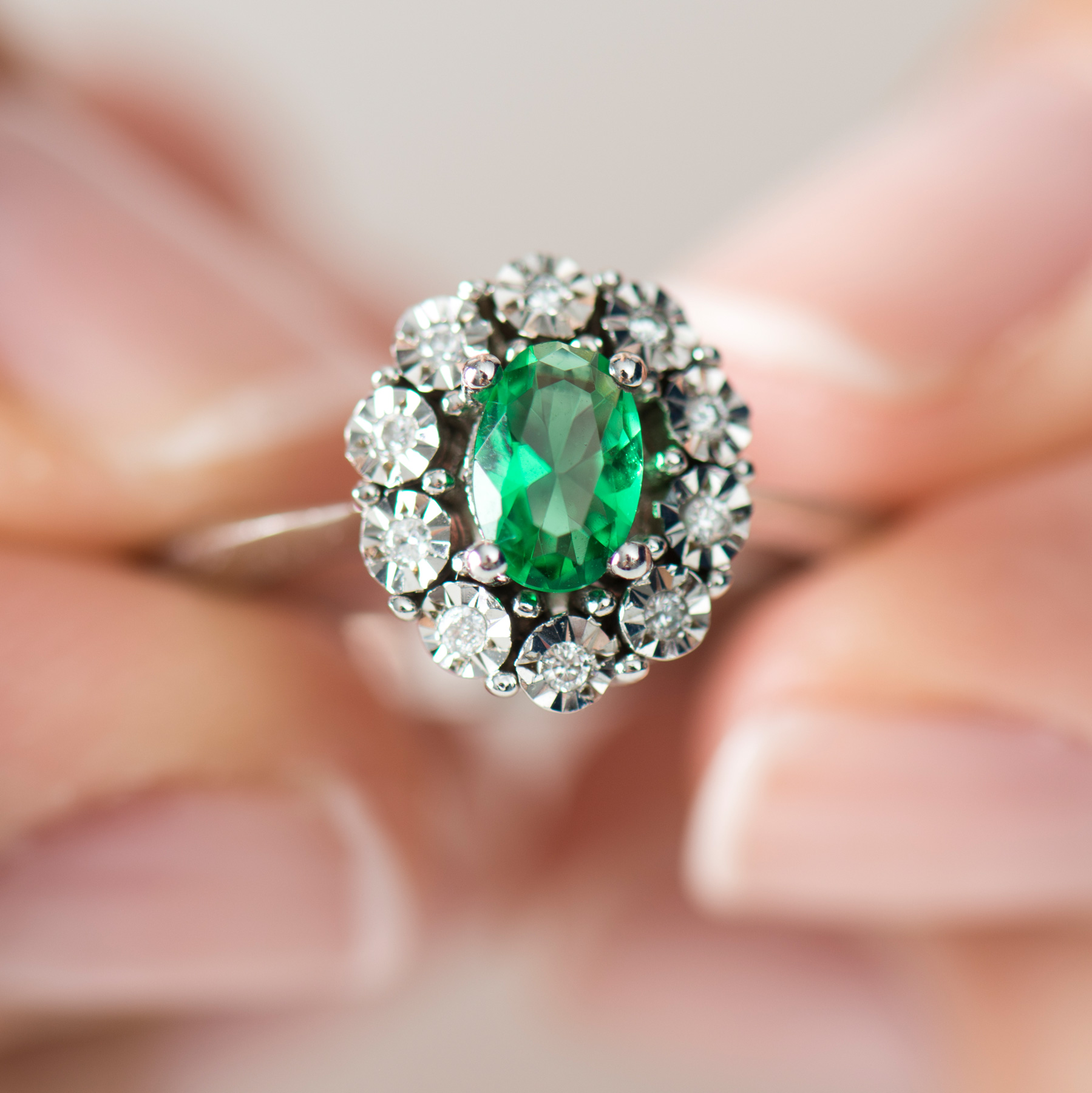 Engagement ring trends 2021: green emerald engagement ring