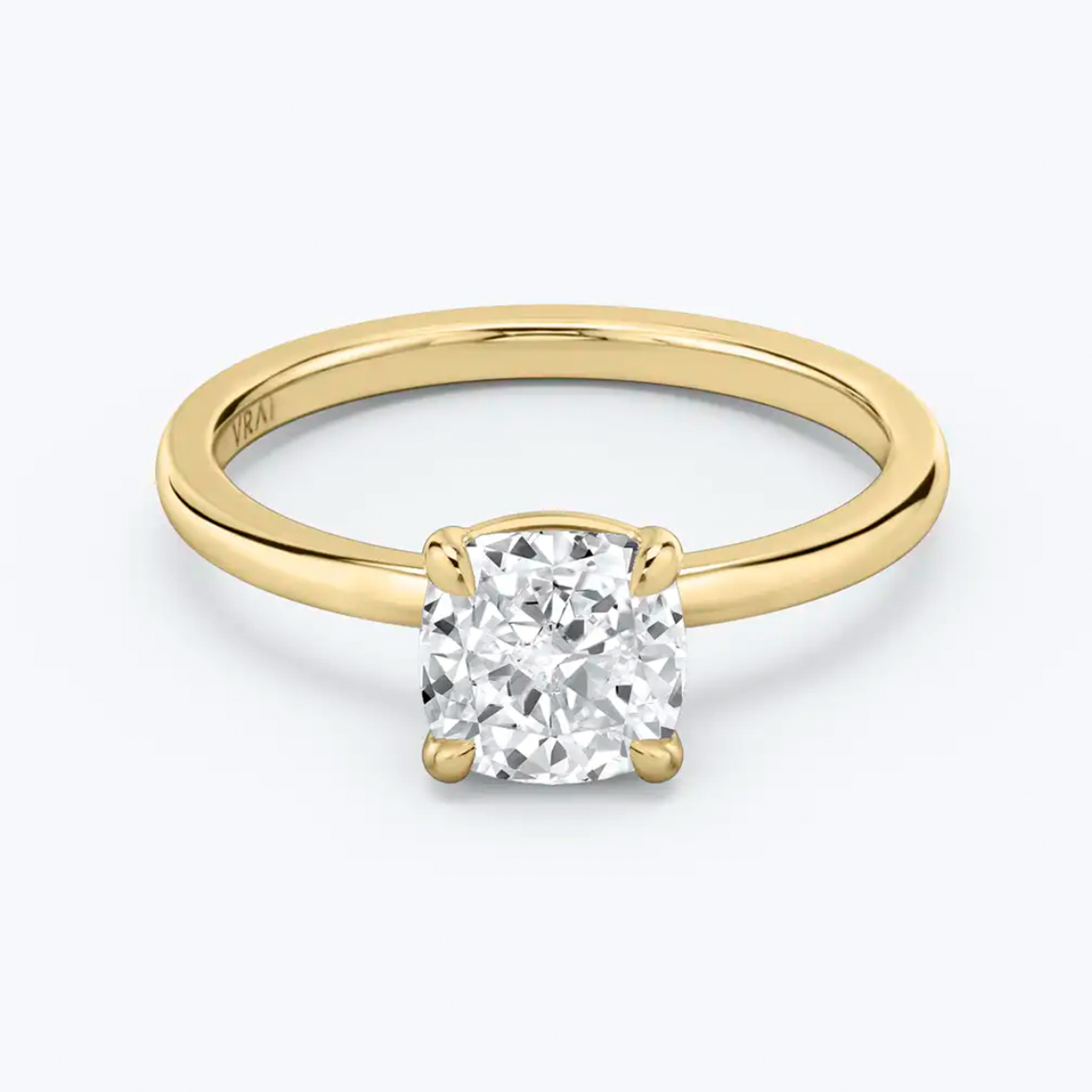 Engagement Ring Trends 2021: Vrai sustainable ethical diamonds, yellow gold and white cushion cut solitaire diamond ring