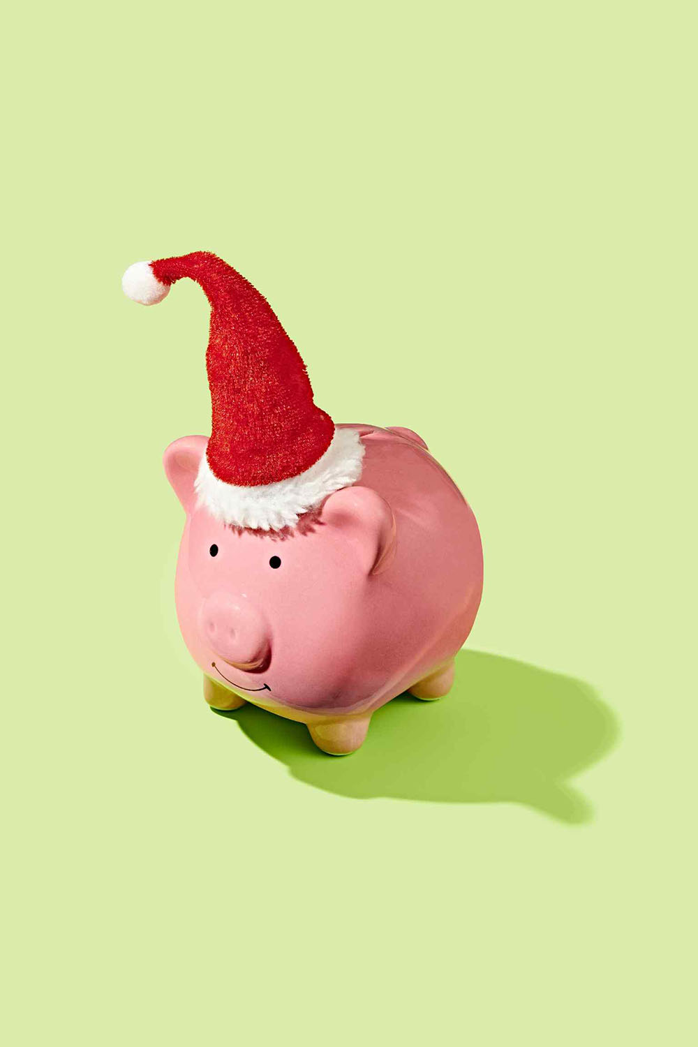 tricks-for-saving-1000-holiday-season: piggy bank with Santa hat