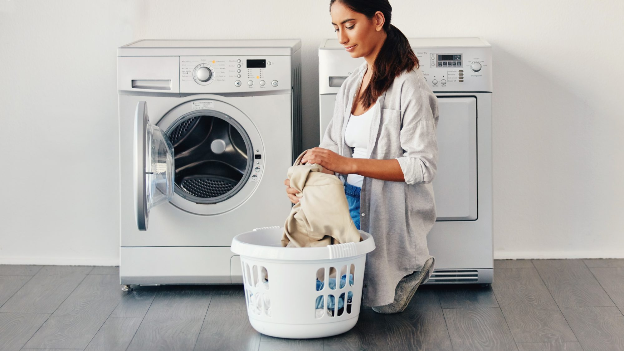 Should You Wash New Sheets, woman doing laundry