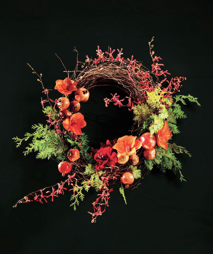Amaryllis, pomegranates, and tiny orchids come together for a magnificent special-occasion wreath that's easier to make than it looks—perfect for a big, splashy greeting at your holiday party. You'll take a branch wreath frame, fresh pomegranates, evergreen branches, blooms, and orchids. Connect all the pieces with floral wire—watch the how-to video (and see the step-by-step guide) here.