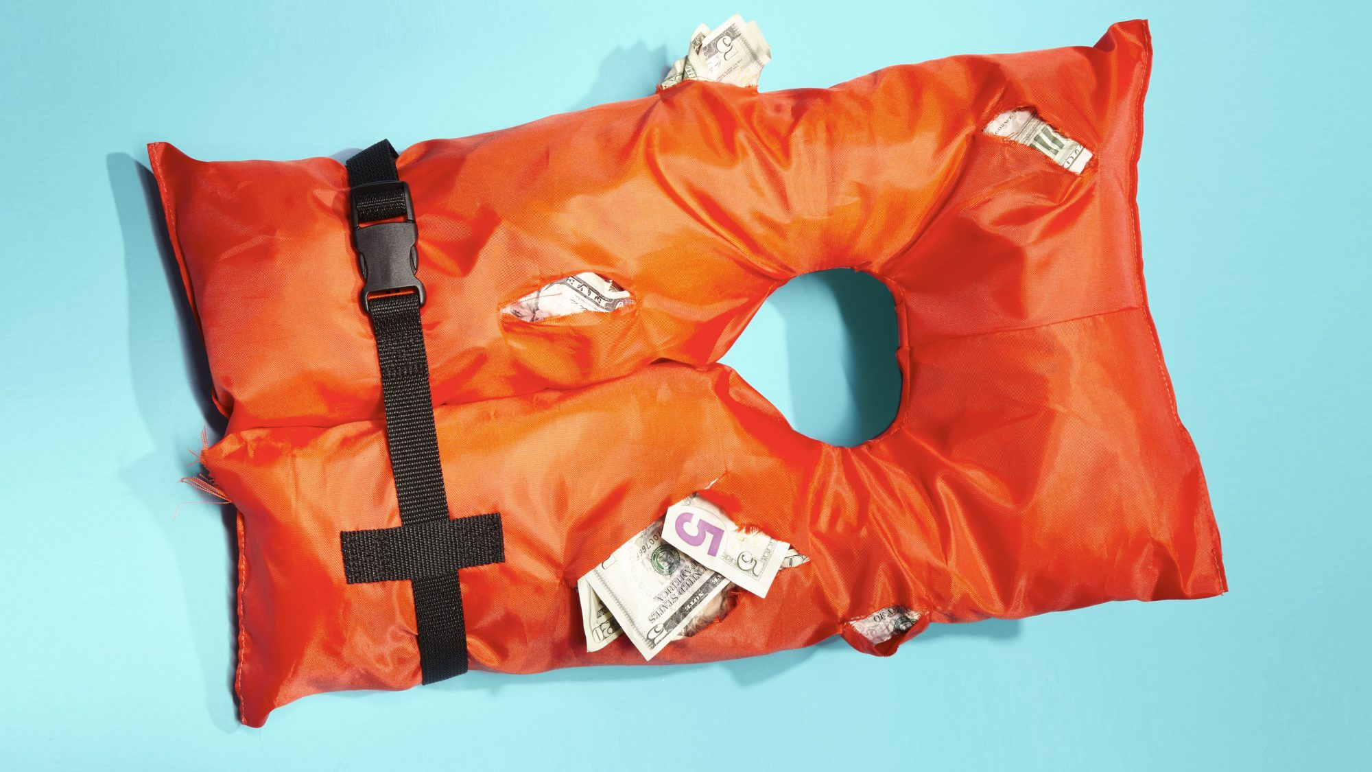 Emergency fund - guide, tips, and more (life jacket with money)