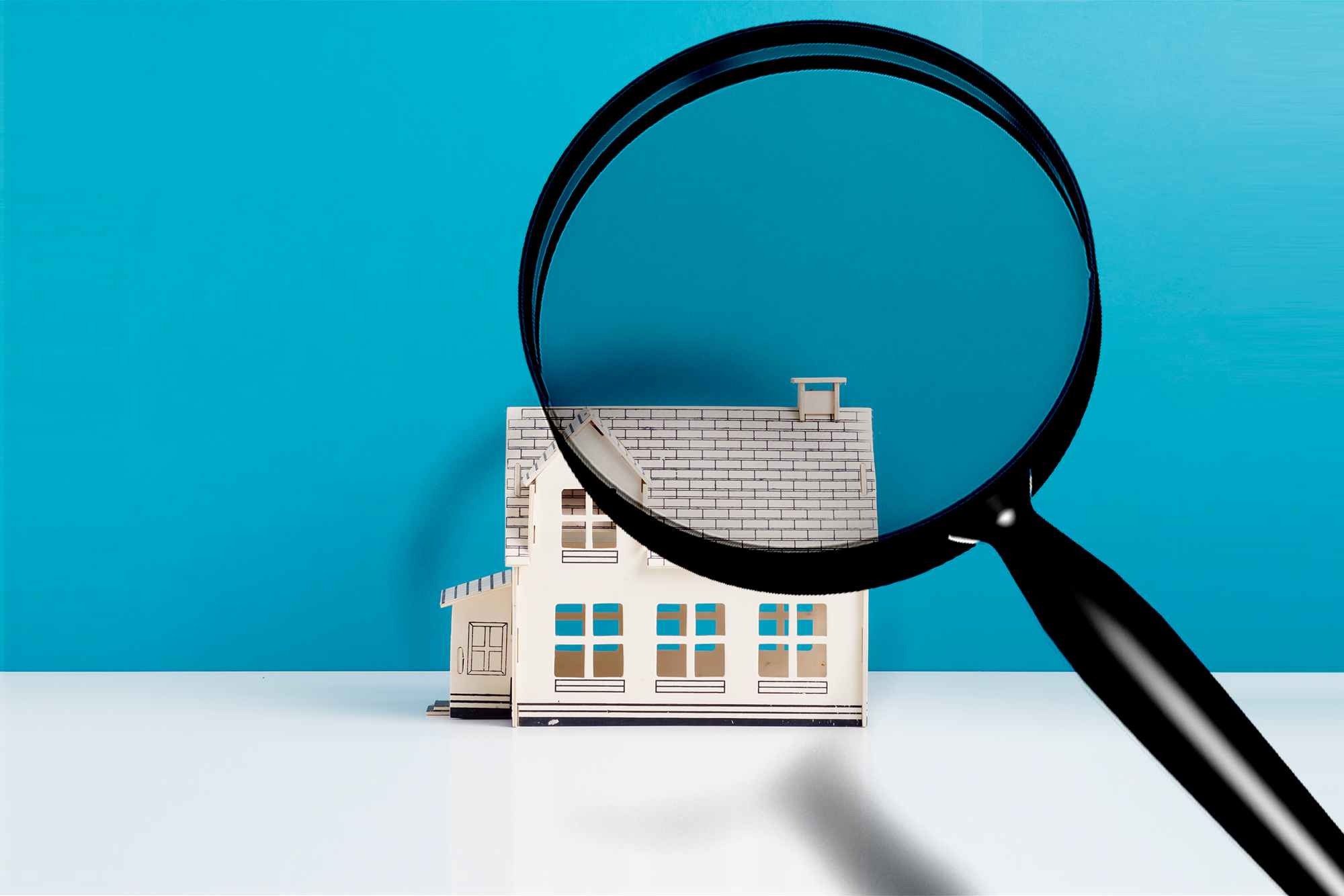 Illustrated magnifying glass and small house