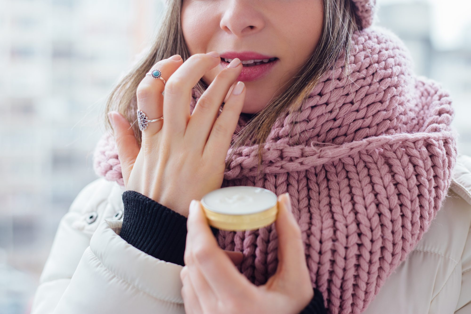 lip-balm-dry-lips: woman applying lip balm
