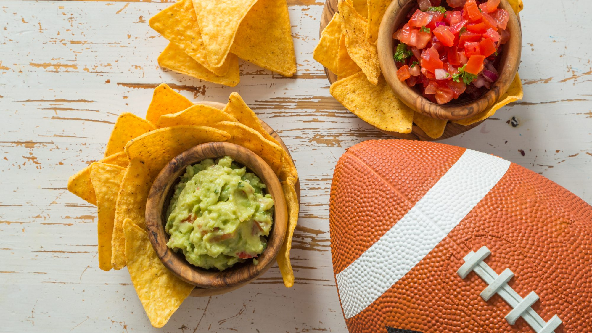 how-to-host-superbowl-outdoors: football, guacamole, salsa