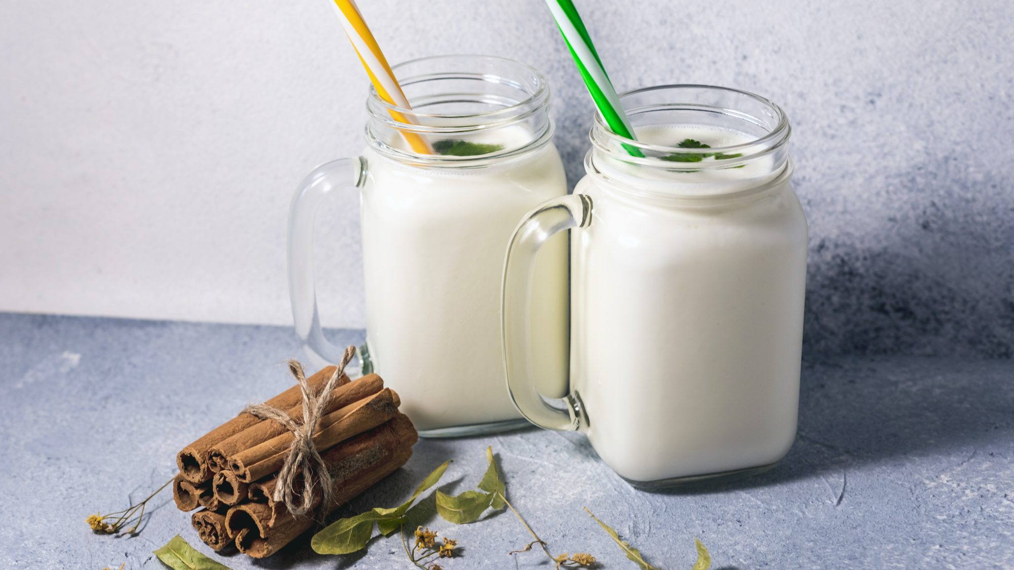 what-is-kefir: two glasses of kefir with straws