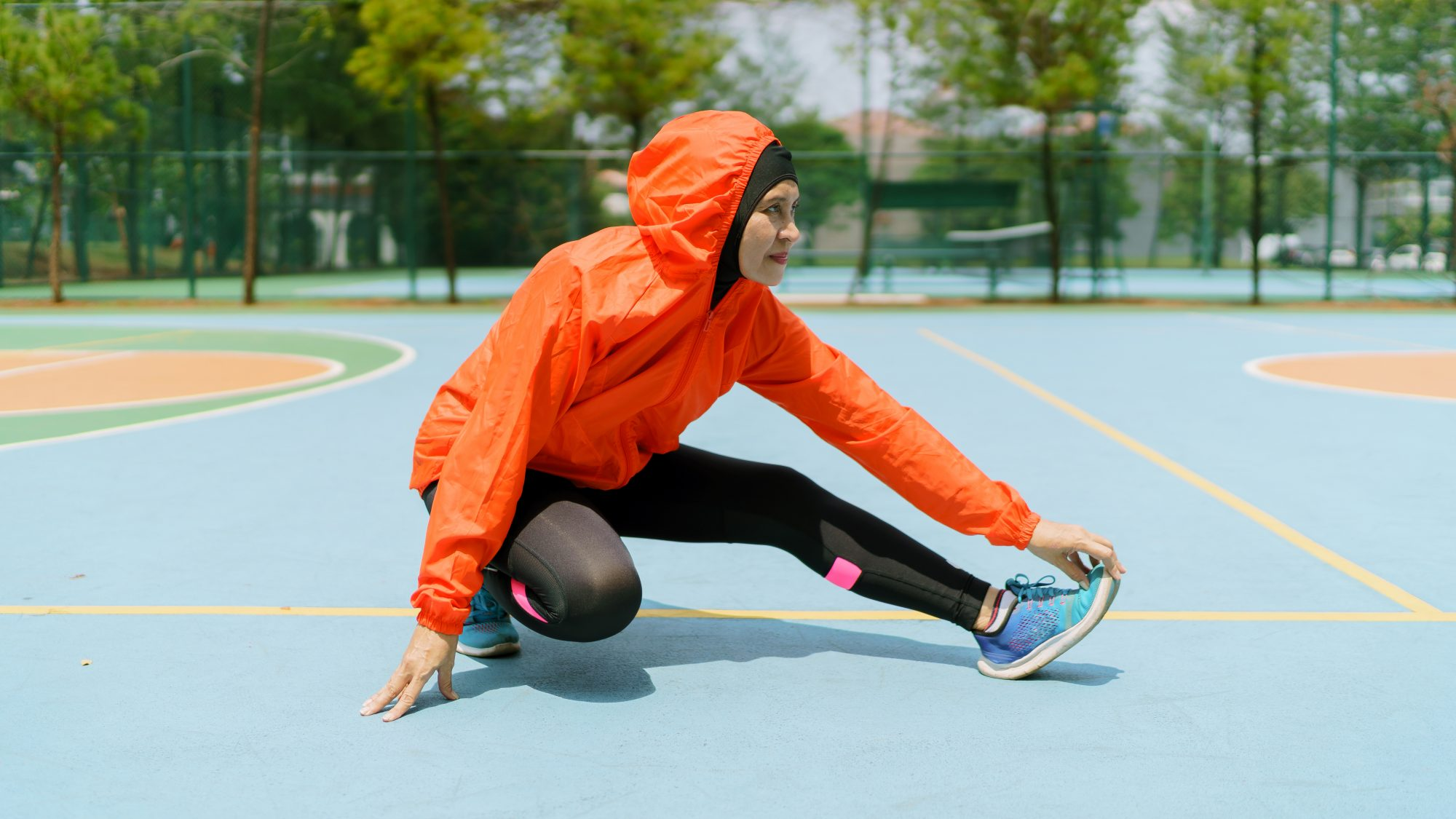 Different Types of Exercise Intensity: woman runner stretching outdoors