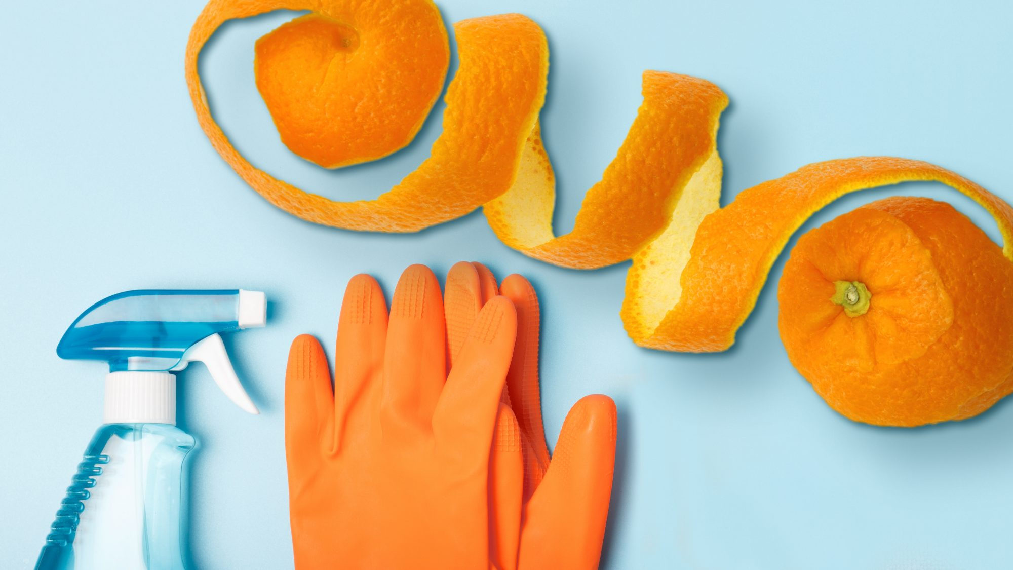 How to Make Orange Peel Cleaning Spray, orange peels and gloves