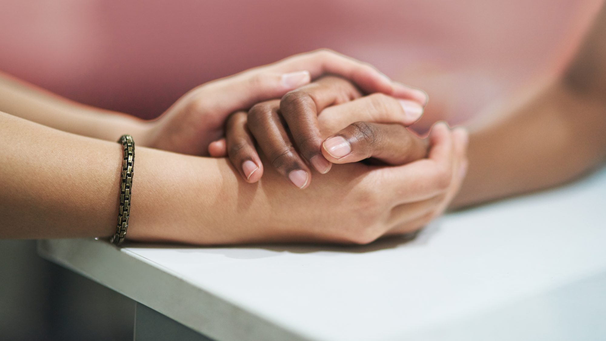 Questions to Ask Your Partner to Build Relationship Intimacy: close up of two people holding hands