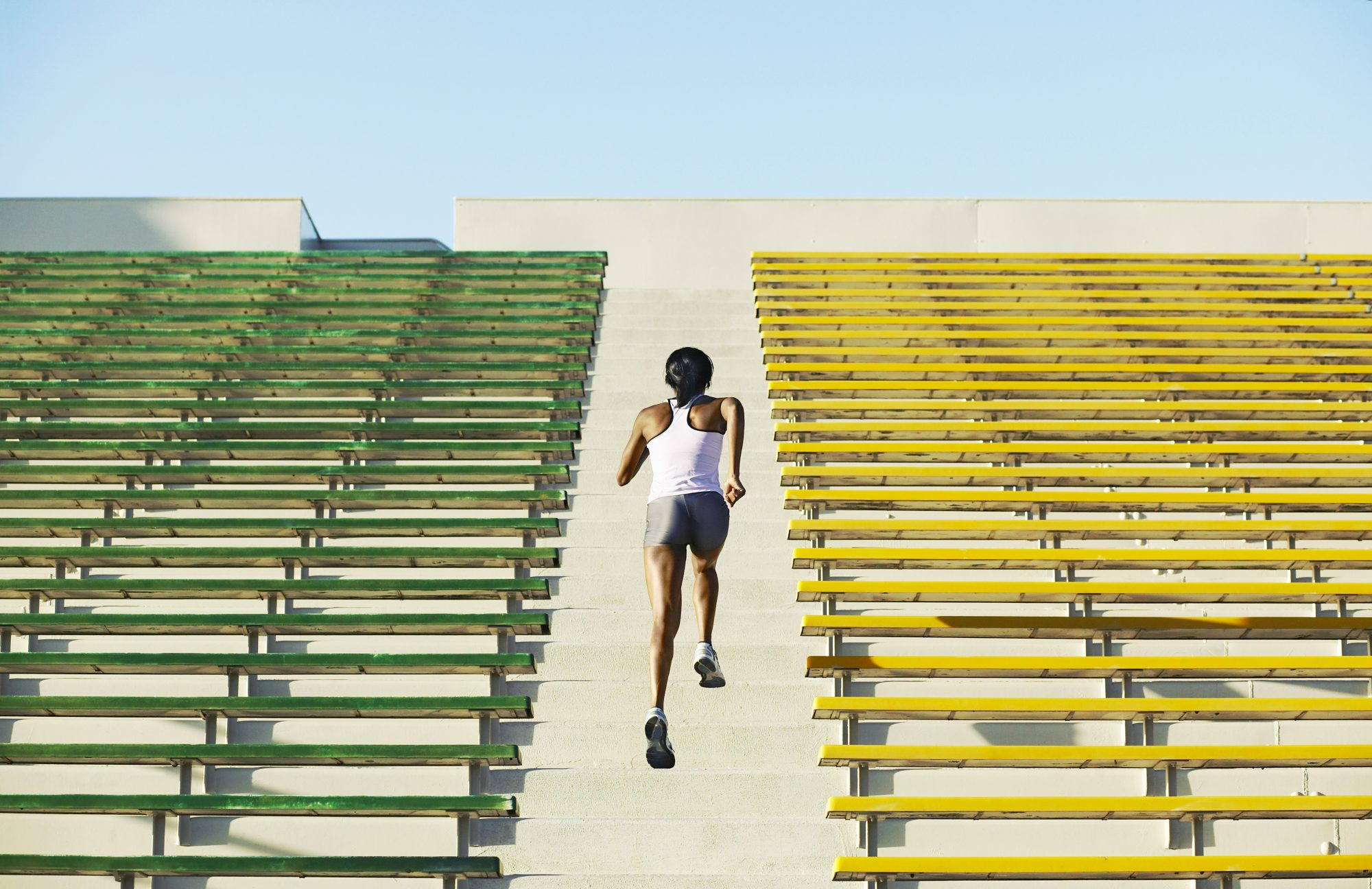 How Exercise Directly Benefits Your Immune System: women running stadium stairs for exercise