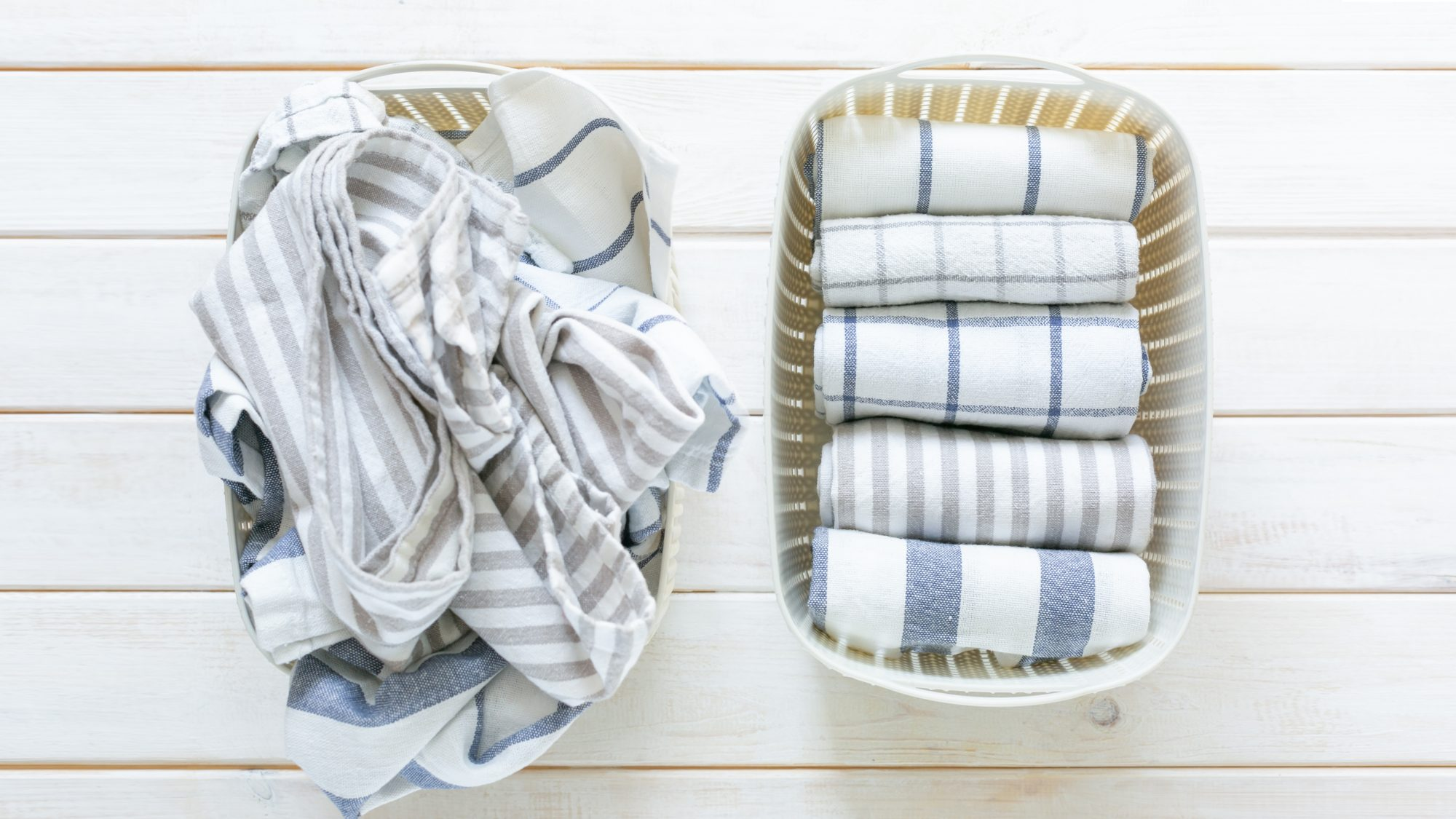 How to Sanitize Laundry: two laundry baskets with towels