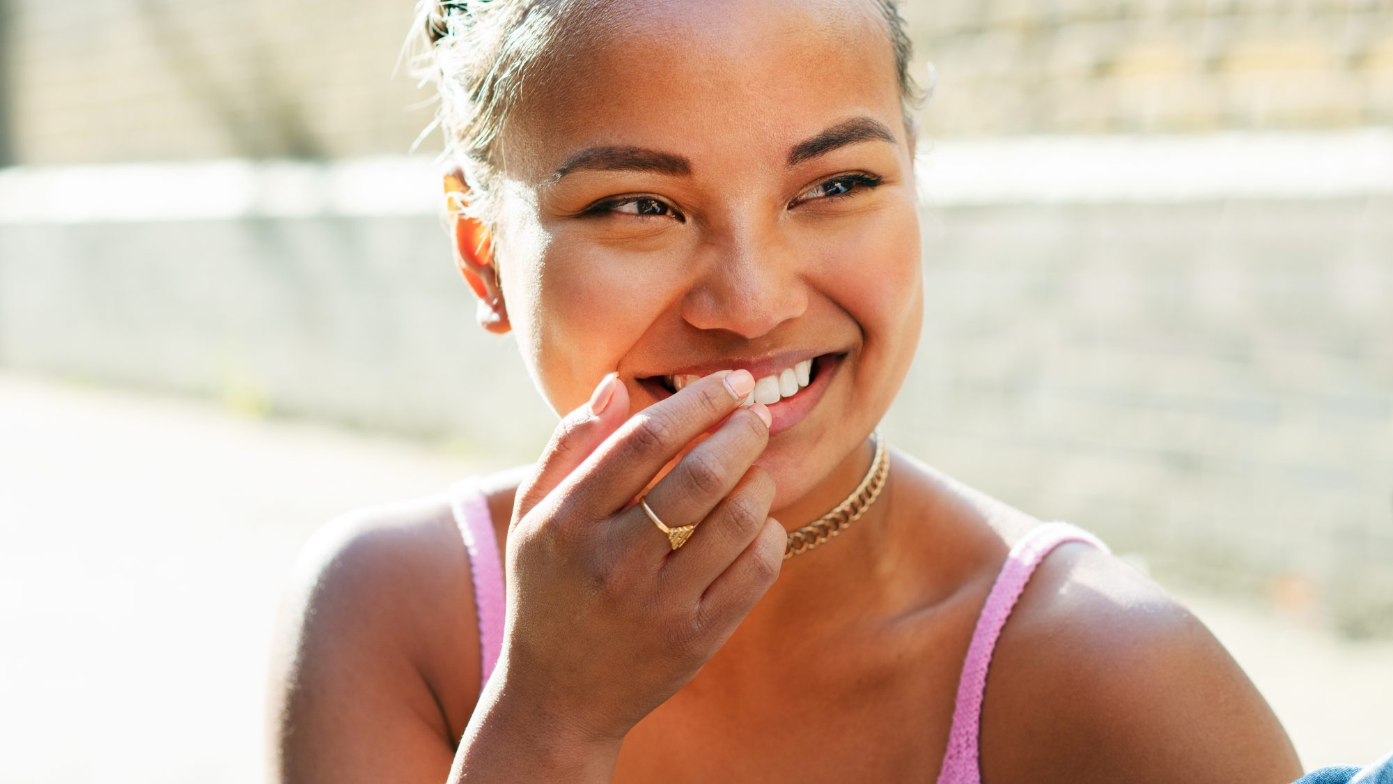 teeth-whitening-mistakes: woman with white teeth smiling