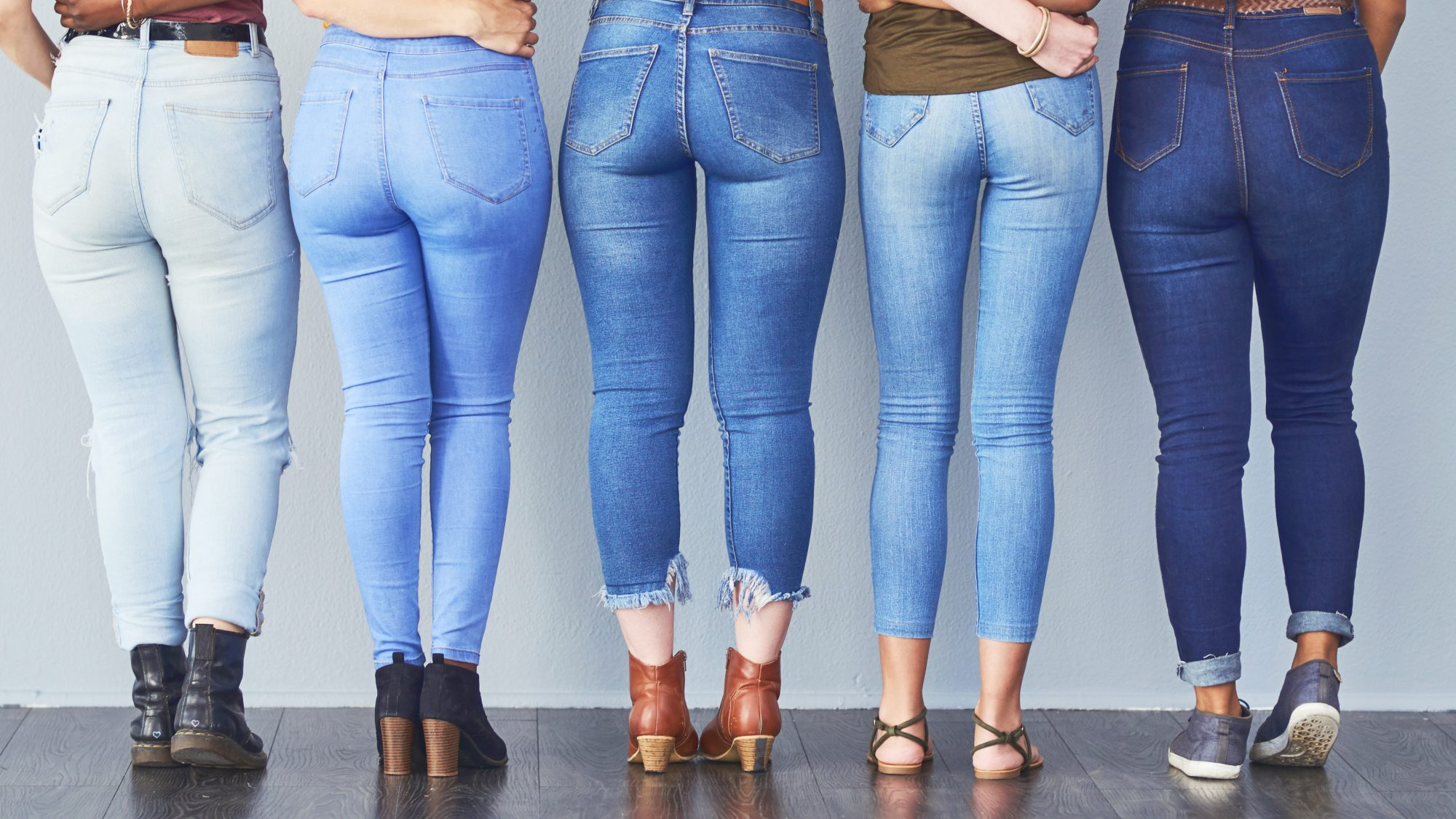 skinny-jeans-gen-z: rearview of several women wearing skinny jeans