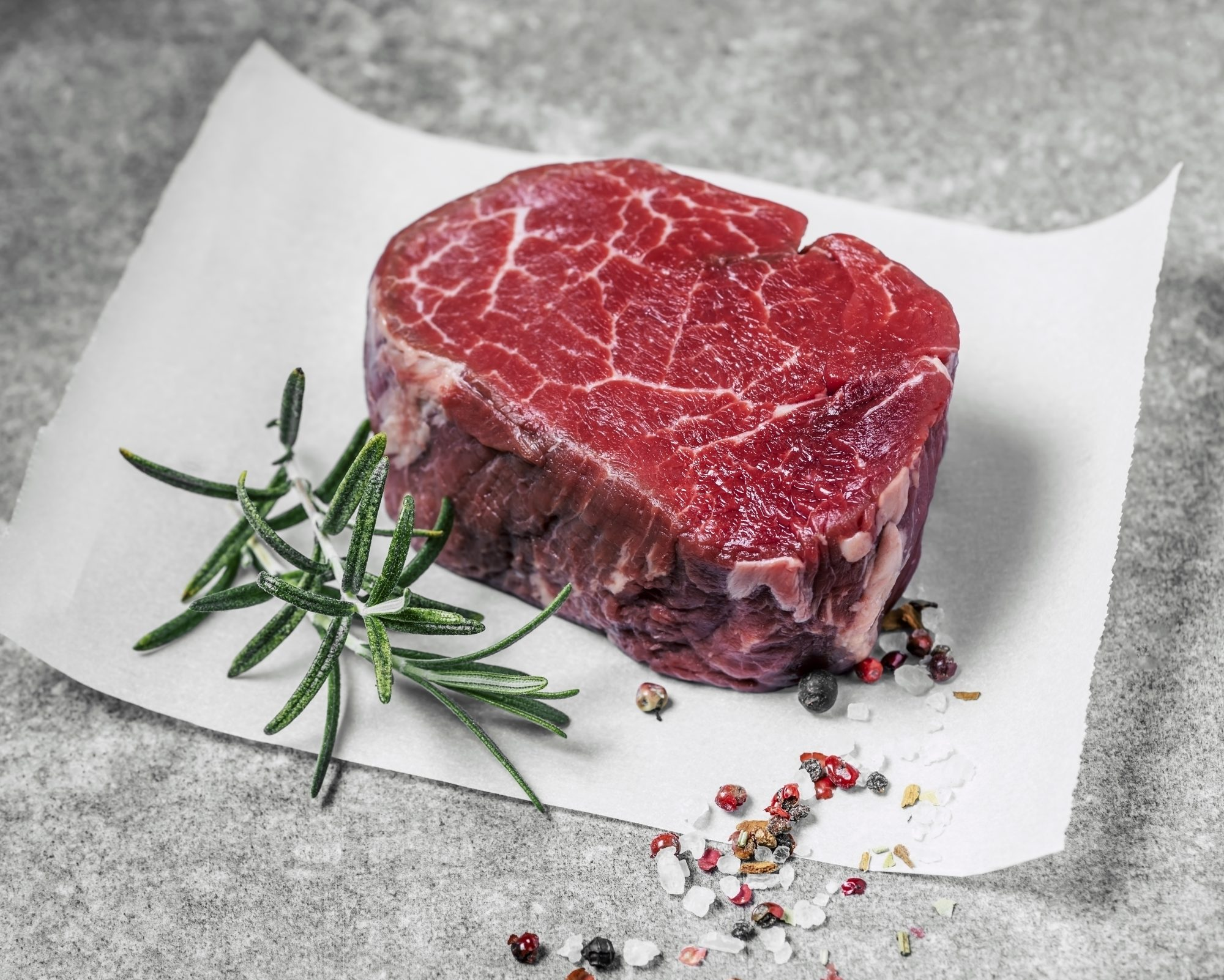 butcher-shopping-tips: marbled piece of steak