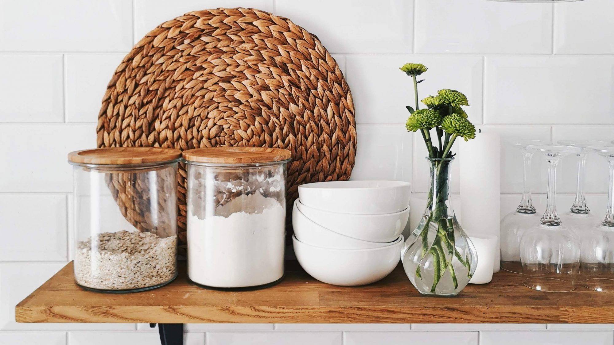 clear-food-storage-containers-guide: clear containers of oats and flour on a shelf