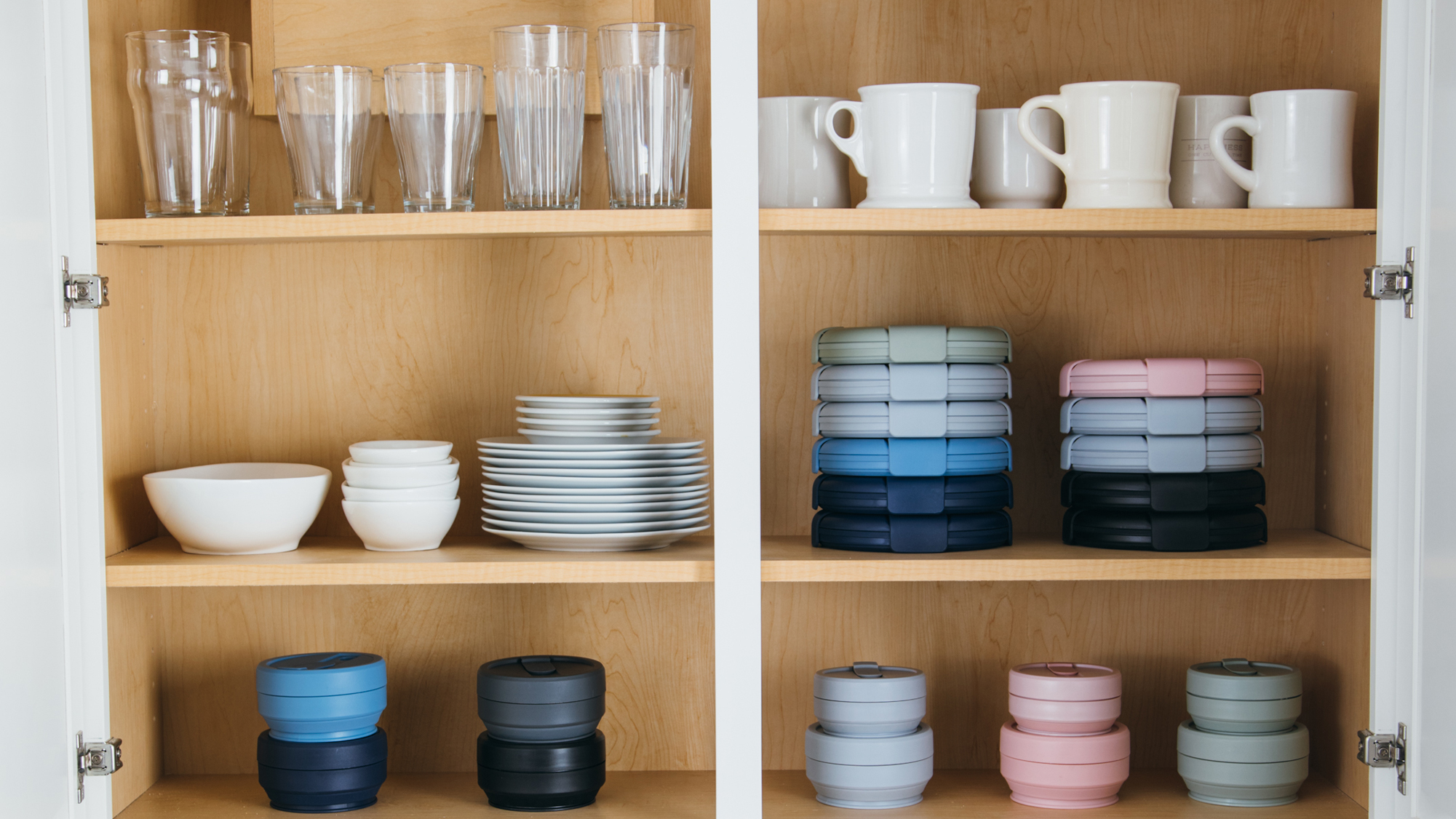 Stojo Foldable Dishes in a kitchen cabinet